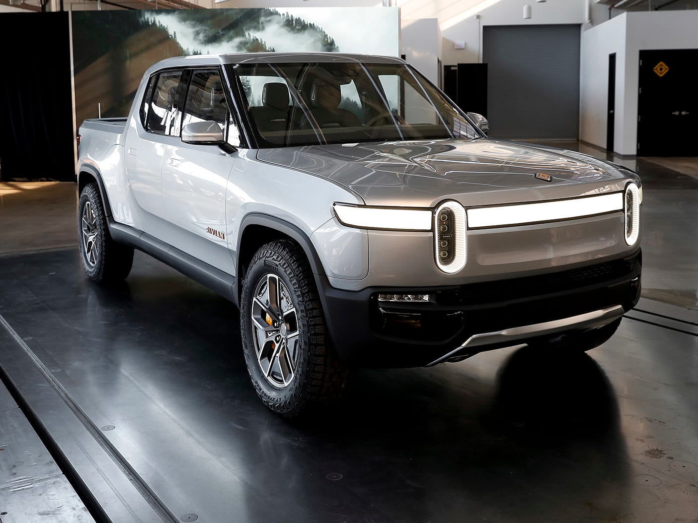 This Wednesday, Nov. 14, 2018, photo shows Rivian R1T at Rivian headquarters in Plymouth, Mich. The company, which plans to start selling vehicles in two years, is another in a growing line of startups and established automakers looking to break into the fully electric vehicle market.