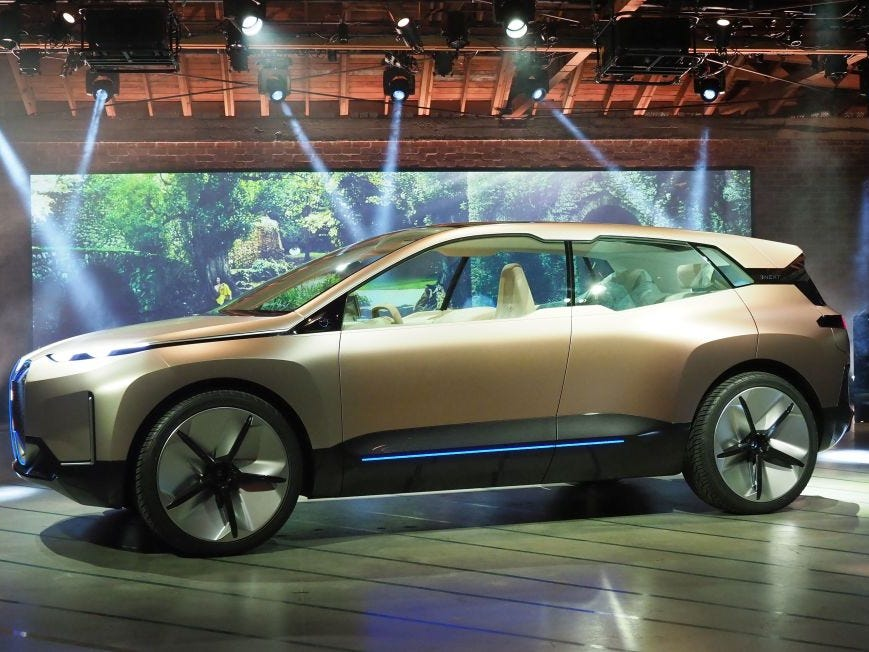 The BMW Vision iNEXT electric car drives autonomously as it enters to be unveiled ahead of the LA Auto Show, November 27, 2018 in Los Angeles.