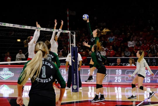 Eastern Michigan's Cassie Haut goes for the kill during the MAC tournament.