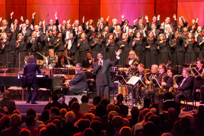 """Tenor Rod Dixon (right) and Alvin Waddle (pianist) perform with Rackham Choir and Michigan Opera Theatre Orchestra instrumentalists during MOT's annual presentation of """"Too Hot To Handel"""" at the Detroit Opera House."""