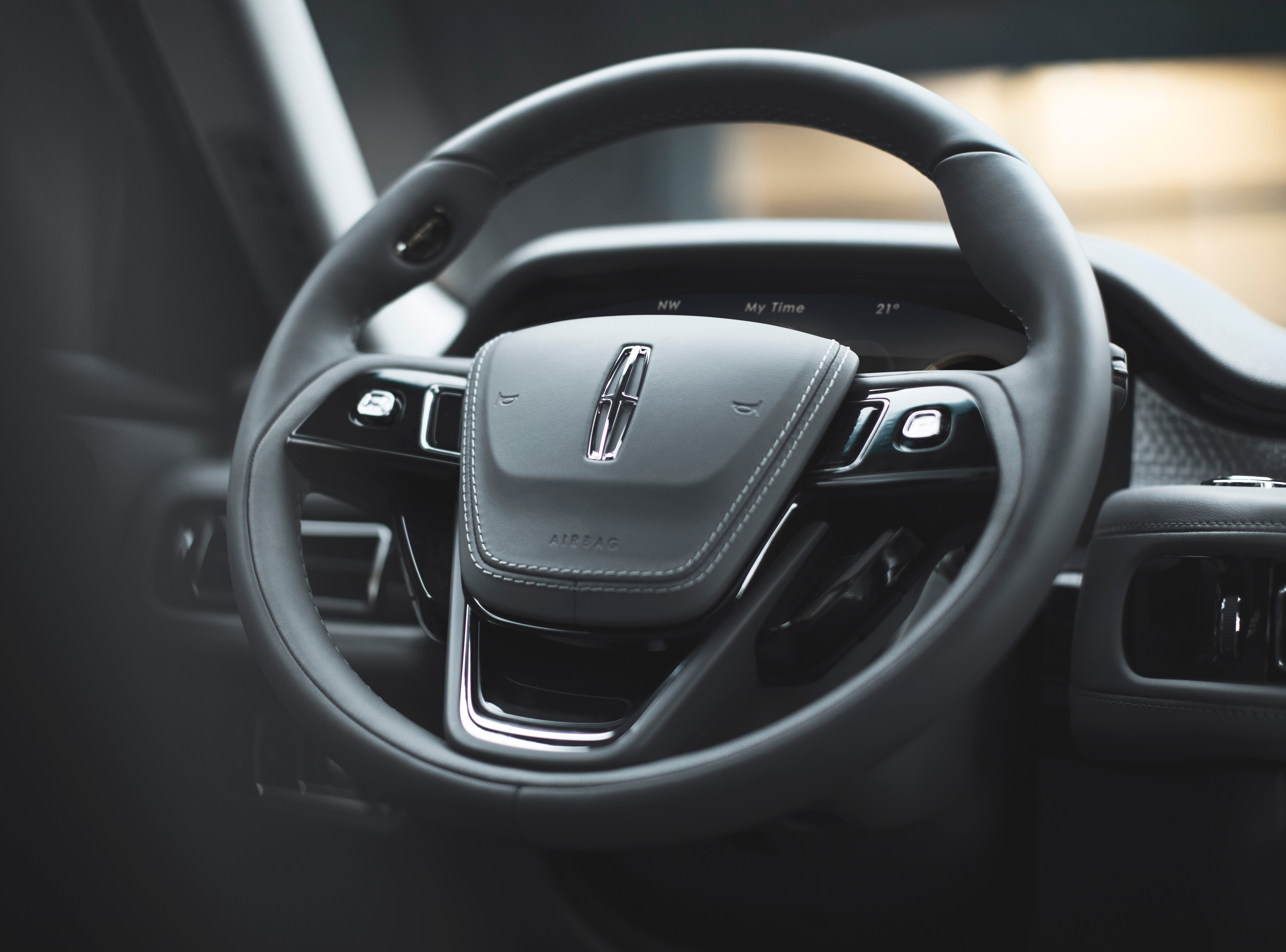 An ergonomically advanced steering wheel is intended for ultimate ease of use and customization; only subtle thumb movements at the 10 o'clock position are needed to access the voice command button. The steering wheel features streamlined, four-way switches at strategic positions to control music, phone and navigation functions.