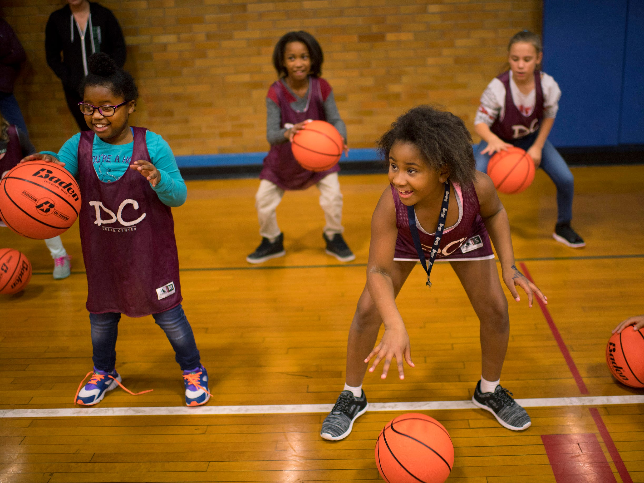 Delmyiah White, 9, left, and Natasha Winstead, 9, get their dribble on at the Ohio Valley Conference Basketball Youth Clinic at the Downtown YMCA Monday afternoon, Oct. 22, 2018.