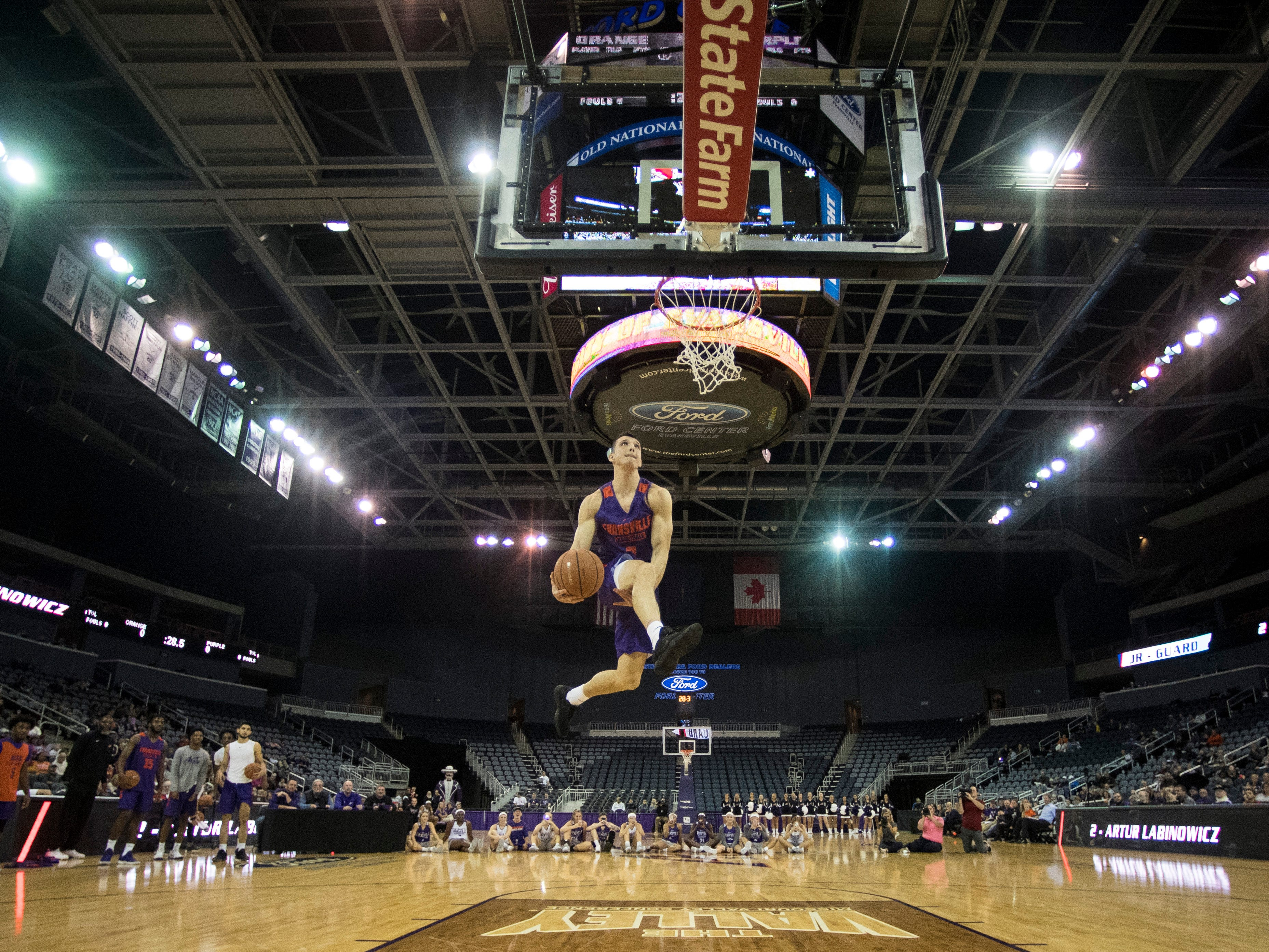 UE's Arthur Labinowicz goes for a between the legs dunk during the dunk contest of the 2018 Hoopfest at the Ford Center Wednesday Oct. 17, 2018.