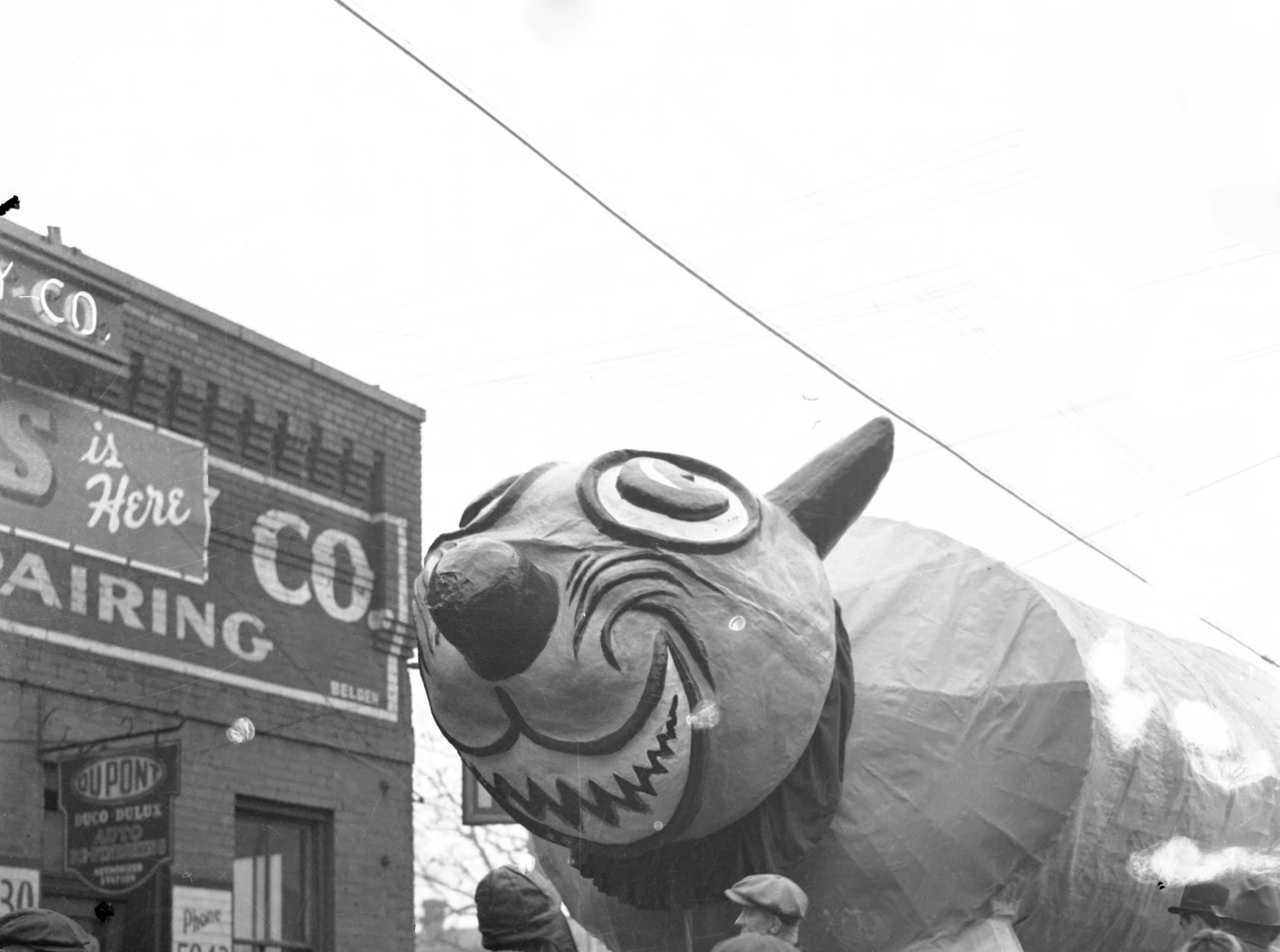 WPA Christmas Parade float--a large animal of some sort, with lots of young people milling about it in 1939.