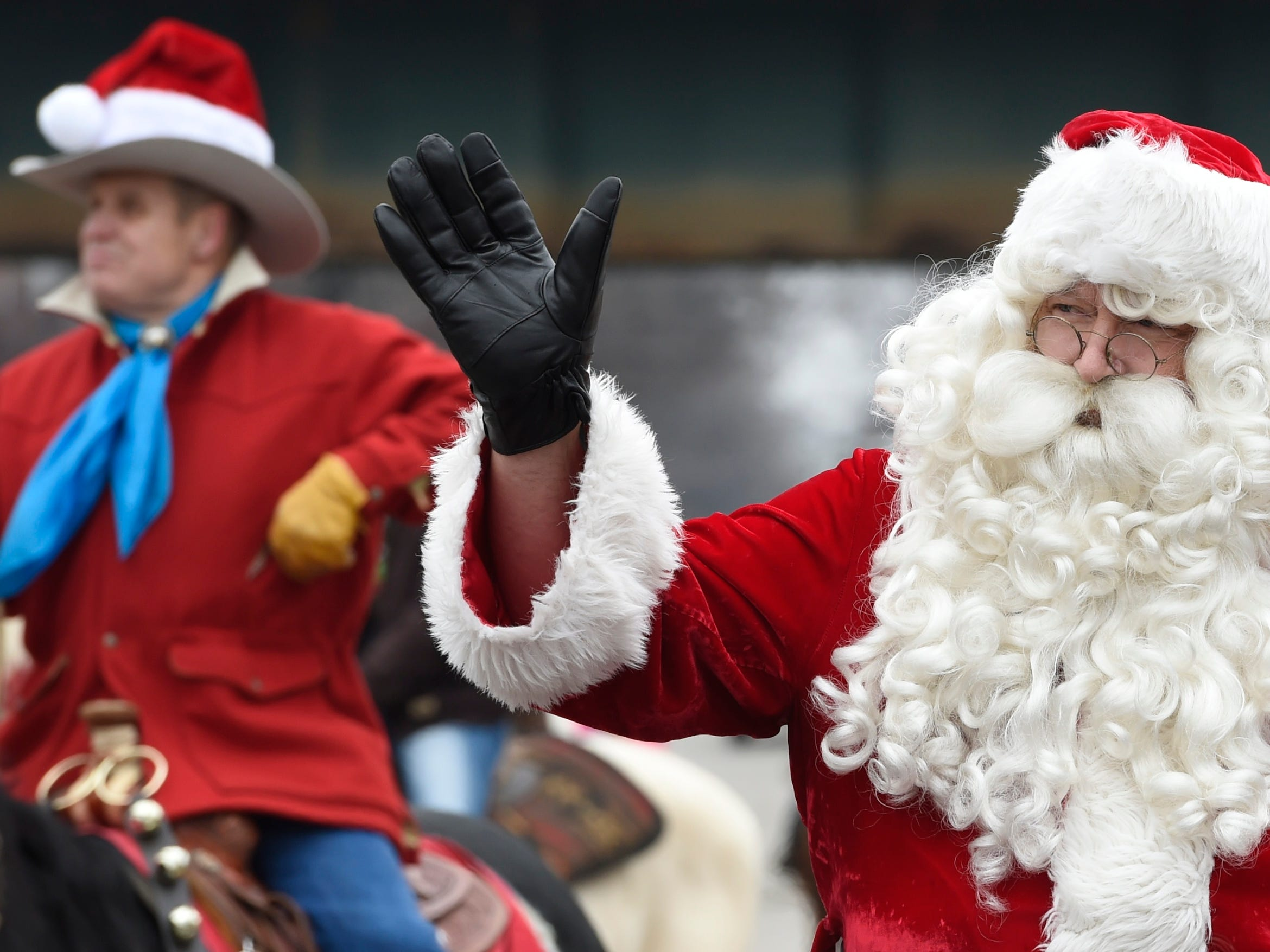 Santa makes his appearance at Saturday's Henderson Shrine Club Merchants Annual Christmas Parade.