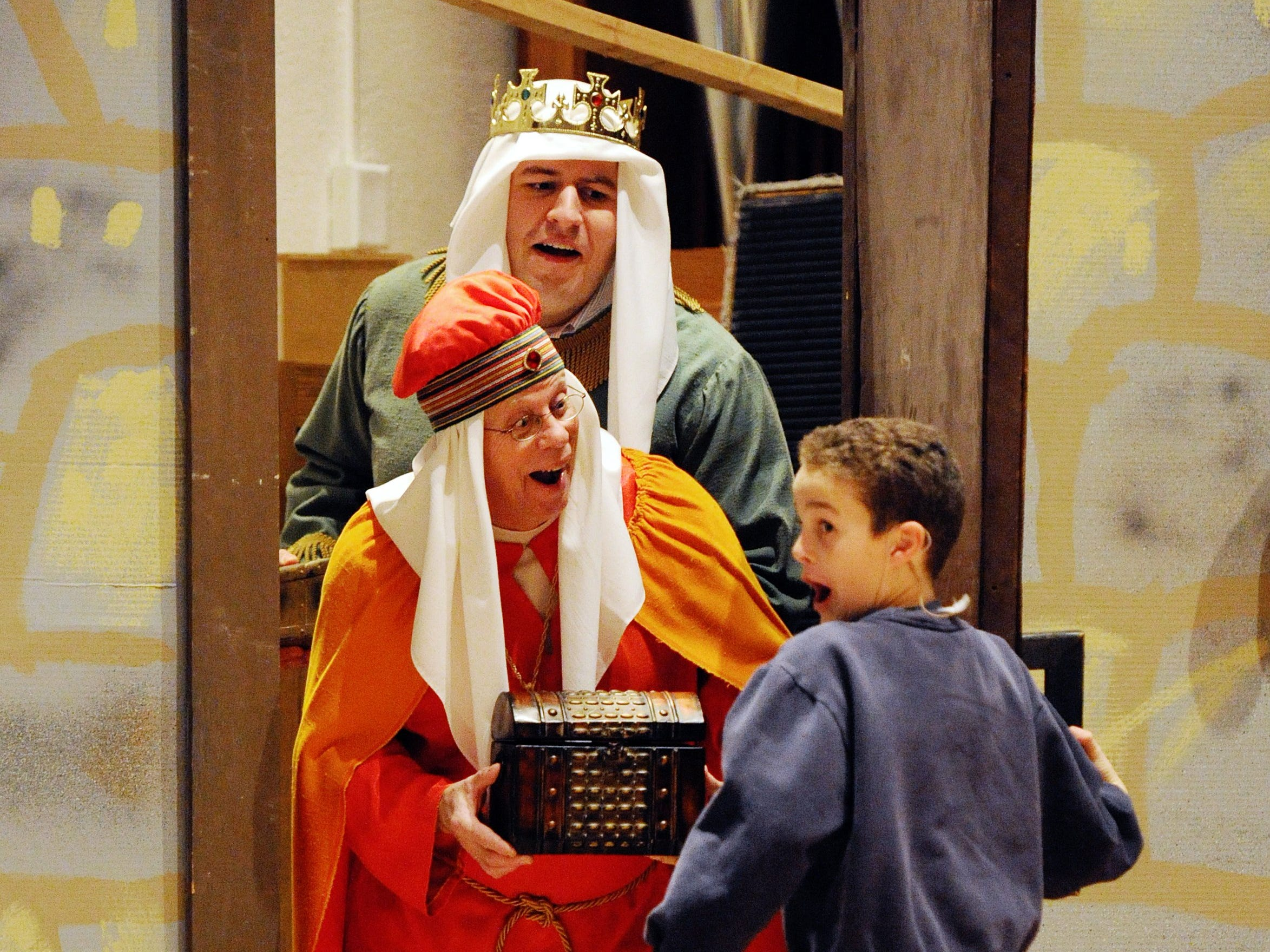 "Elias Courter, 11, rehearses a scene from Gian-Carlo Menotti's ""Amahl and the Night Visitors,"" with fellow cast members, Mark Schweickart, center, and Jason Jett, back center, at Methodist Temple in Evansville on Tuesday, December 10, 2013.  Courter plays Amahl in the lead role.  The Christmas opera will be performed at 3 p.m. and 6 p.m. on Sunday, December 15 at the Temple."