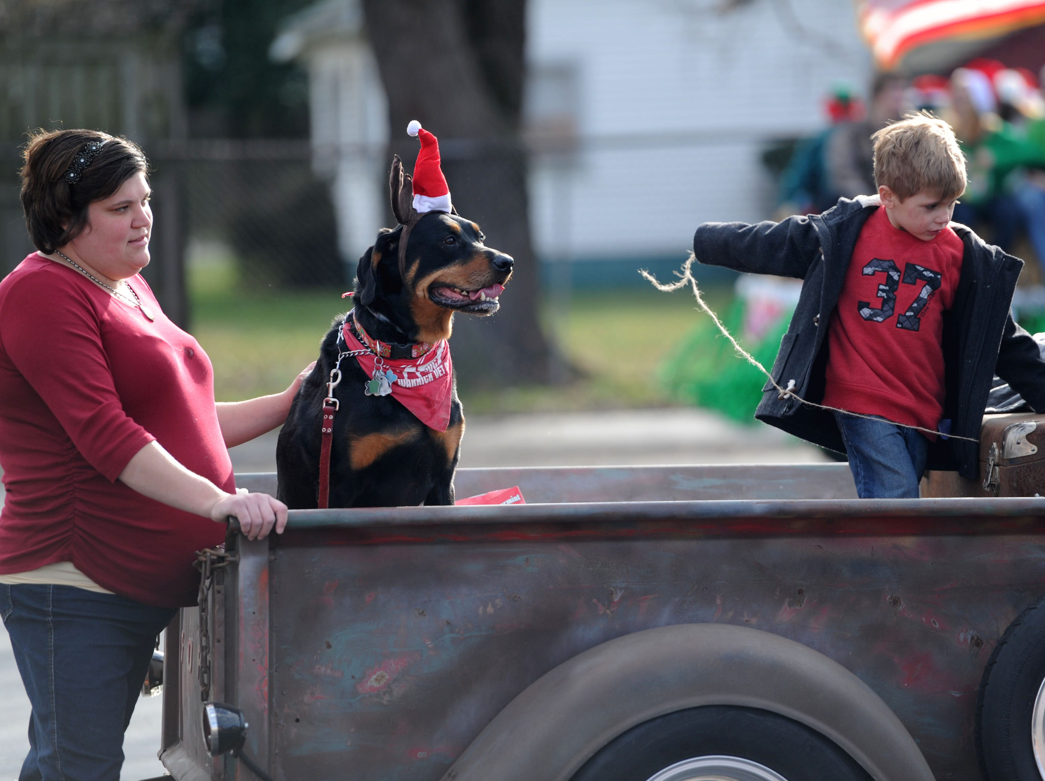 Hillary Paff and Gage Paff wait with their dog Jarvis before the Boonville Christmas Parade in downtown Boonville on Sunday, Dec. 6, 2015.