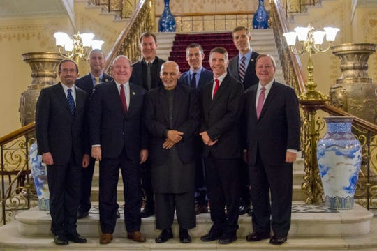 8th District Rep. Larry Bucshon, first row, second left, poses with Afghanistan's President Ashraf Ghani, front center, and the American delegation during a visit to Afghanistan.