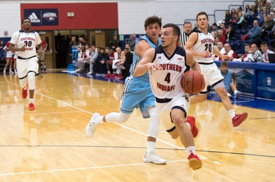 USI's Braden Fitzjerrells (4)  drives the ball to the basket during the USI vs Oakland City Men's basketball game at the PAC Tuesday, Nov. 27, 2018.