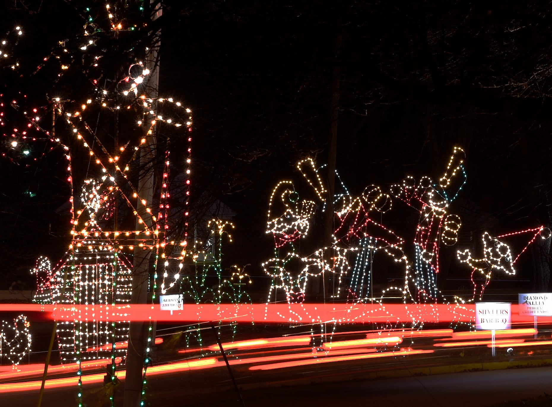 Visitors taillights streak through the Ritzy's Fantasy of Lights in Garvin Park. The light display, which raised more than $145,000 last year for Easter Seals, will remain up through Jan. 1, New Years night.