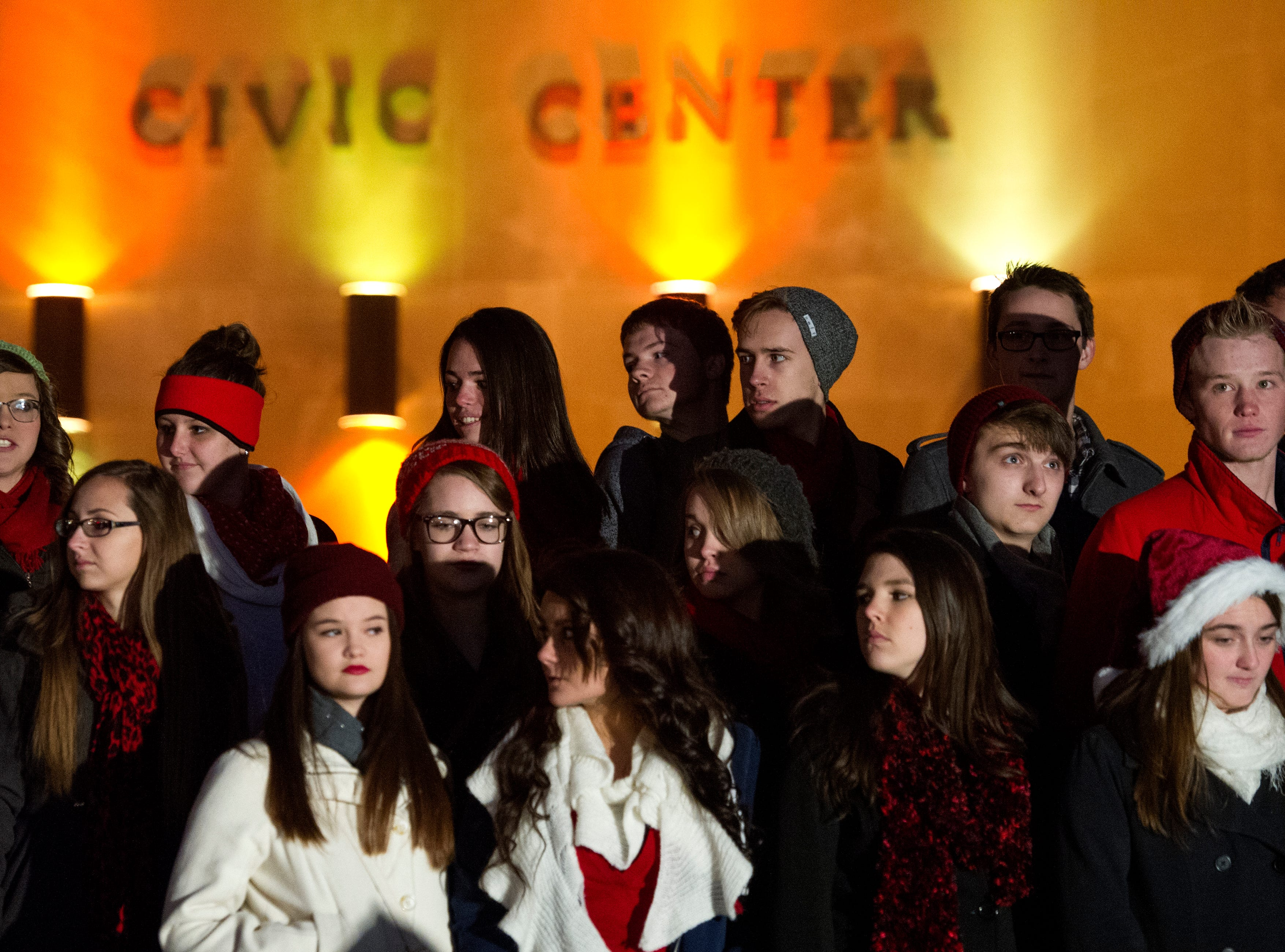 The Central High School concert choir prepares to sing during the lighting of the Civic Center Christmas treeThursday, Nov. 20, 2014.