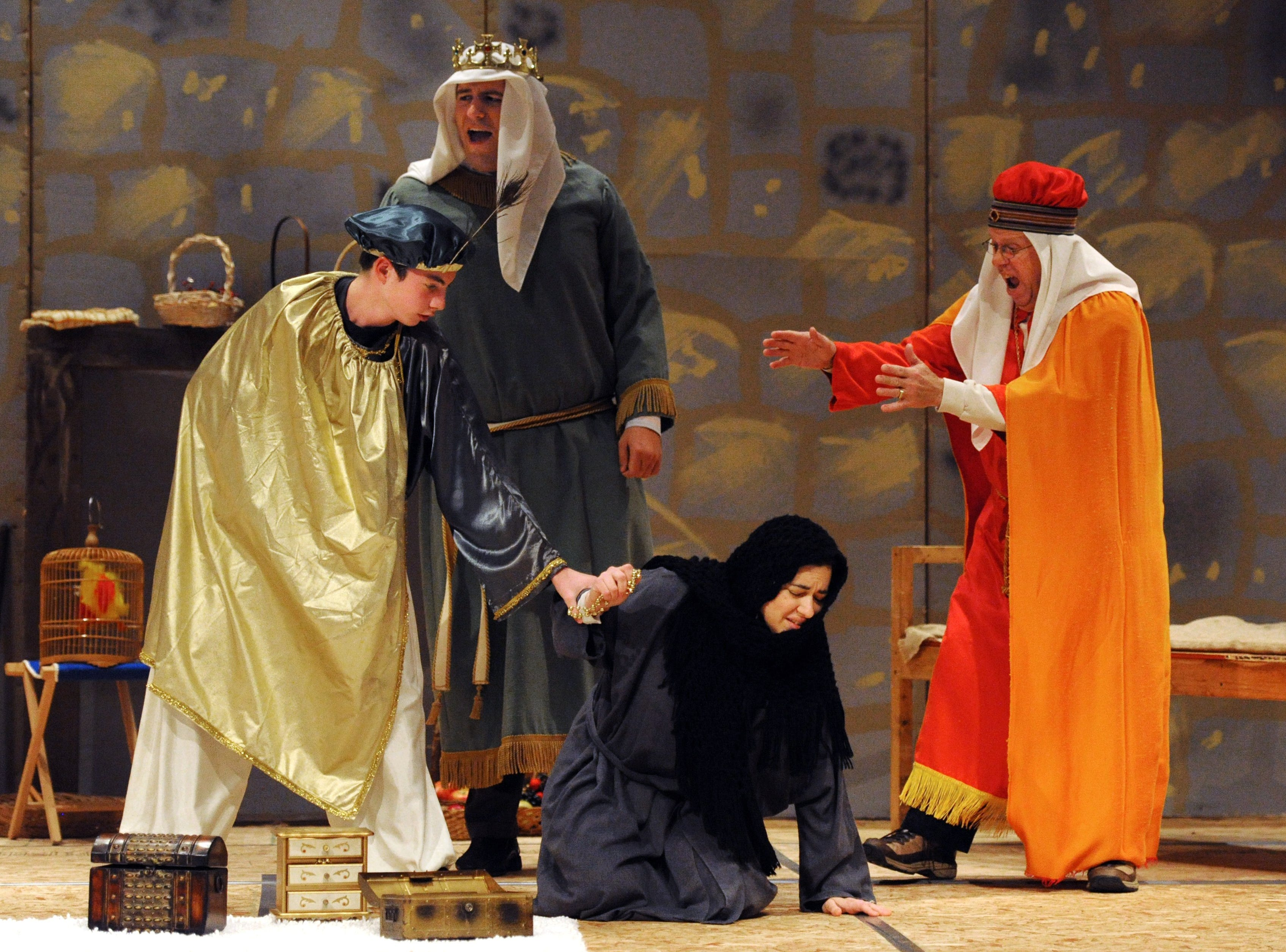"Carrie Aiken, center, rehearses a scene from Gian-Carlo Menotti's ""Amahl and the Night Visitors,"" with fellow cast members, Emerson Courter, 14, left, Jason Jett, back center, and Mark Schweickart, right, and at Methodist Temple in Evansville on Tuesday, December 10, 2013.  The Christmas opera will be performed at 3 p.m. and 6 p.m. on Sunday, December 15 at the Temple."