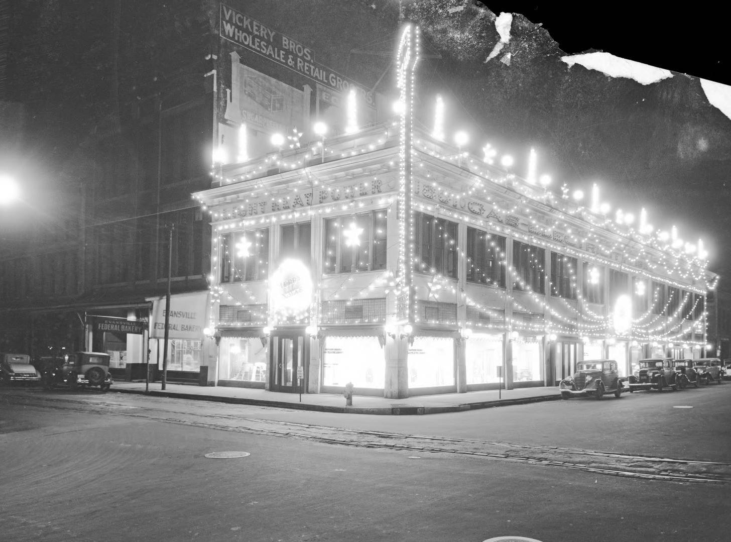 SIGECO office lit up for Christmas Also known as the Skora building at 2nd and Sycamore, across from the post office in 1934.