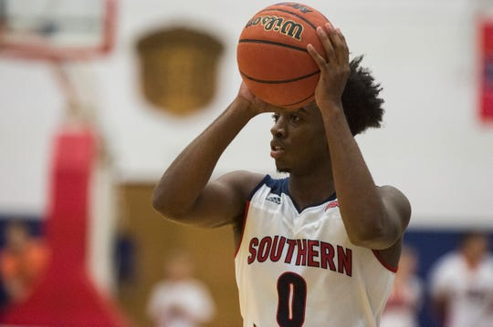USI's Kobe Caldwell (0) looks to pass the ball during the USI vs Oakland City Men's basketball game at the PAC Tuesday, Nov. 27, 2018.