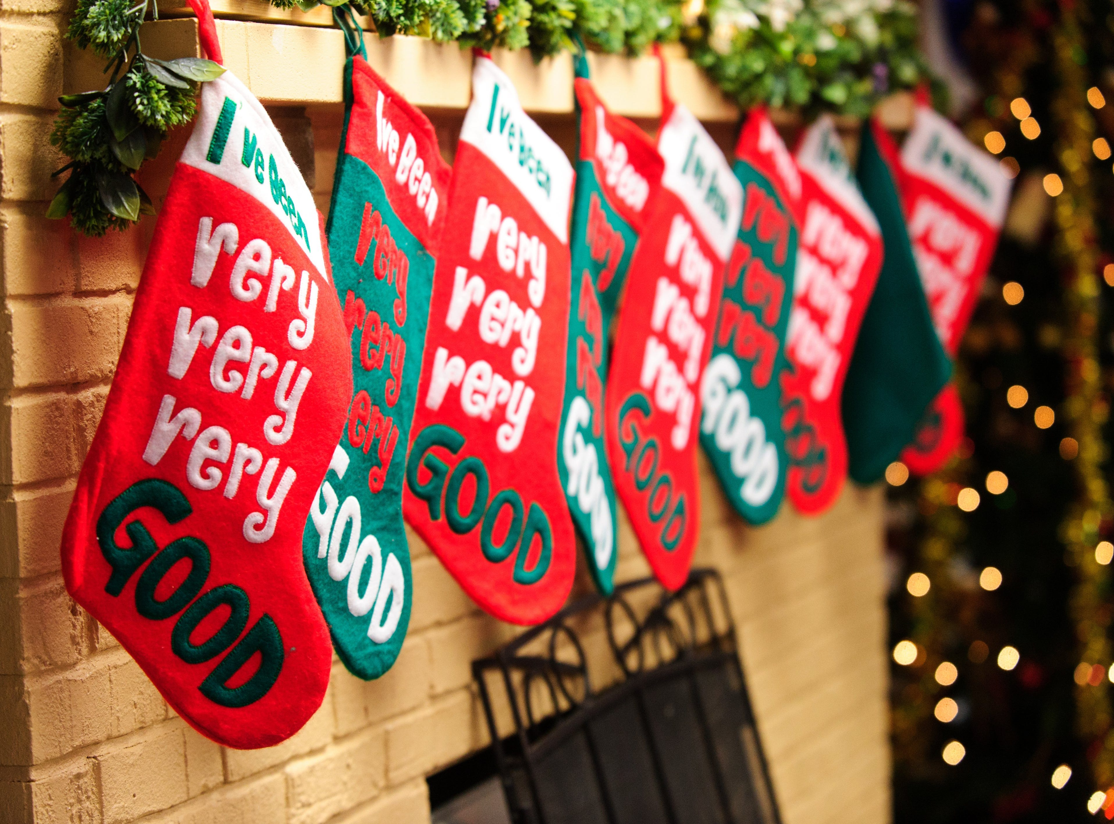 """I've been very very very good"" stockings hung off the mantle at  at FOP Camp on Happe Road on Evansville Northwest side Saturday morning Dec. 14, 2013 before the arrival of 82 school children, K thru 2nd graders for the annual FOP Christmas party. For close to 50 years the FOP has been have Christmas party for Evansville's needy children."