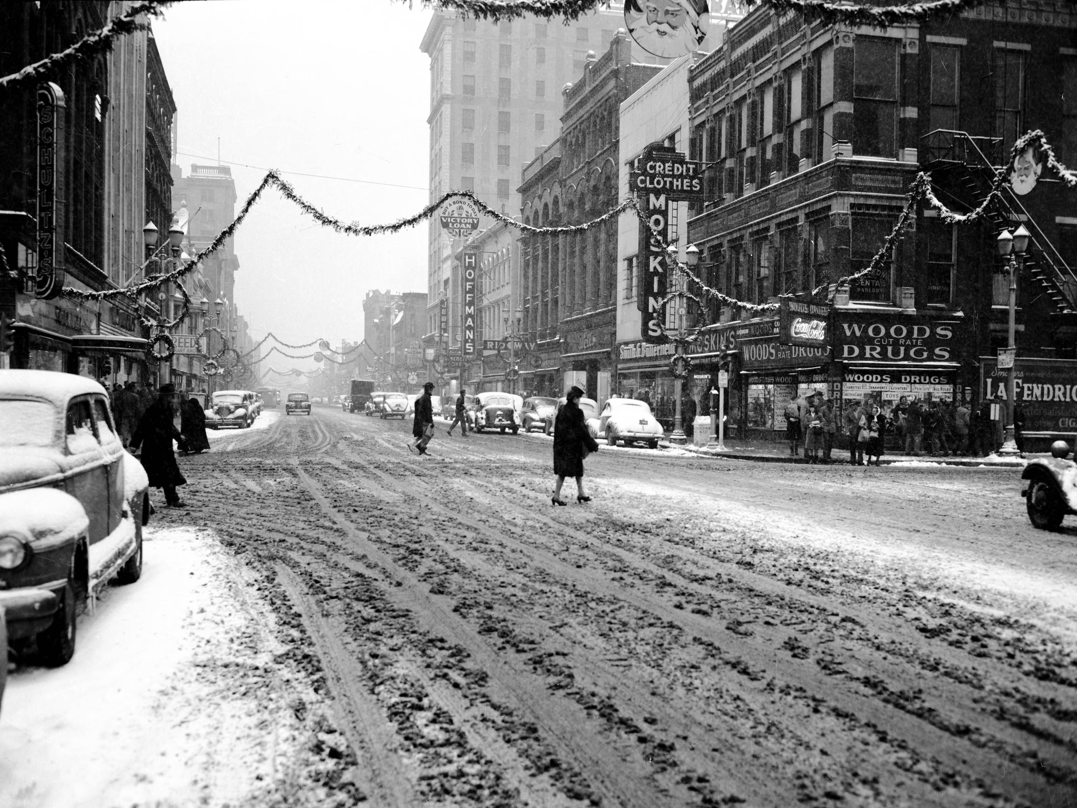 300 block of Main St., with snow on the ground and Christmas decorations up in 1945.