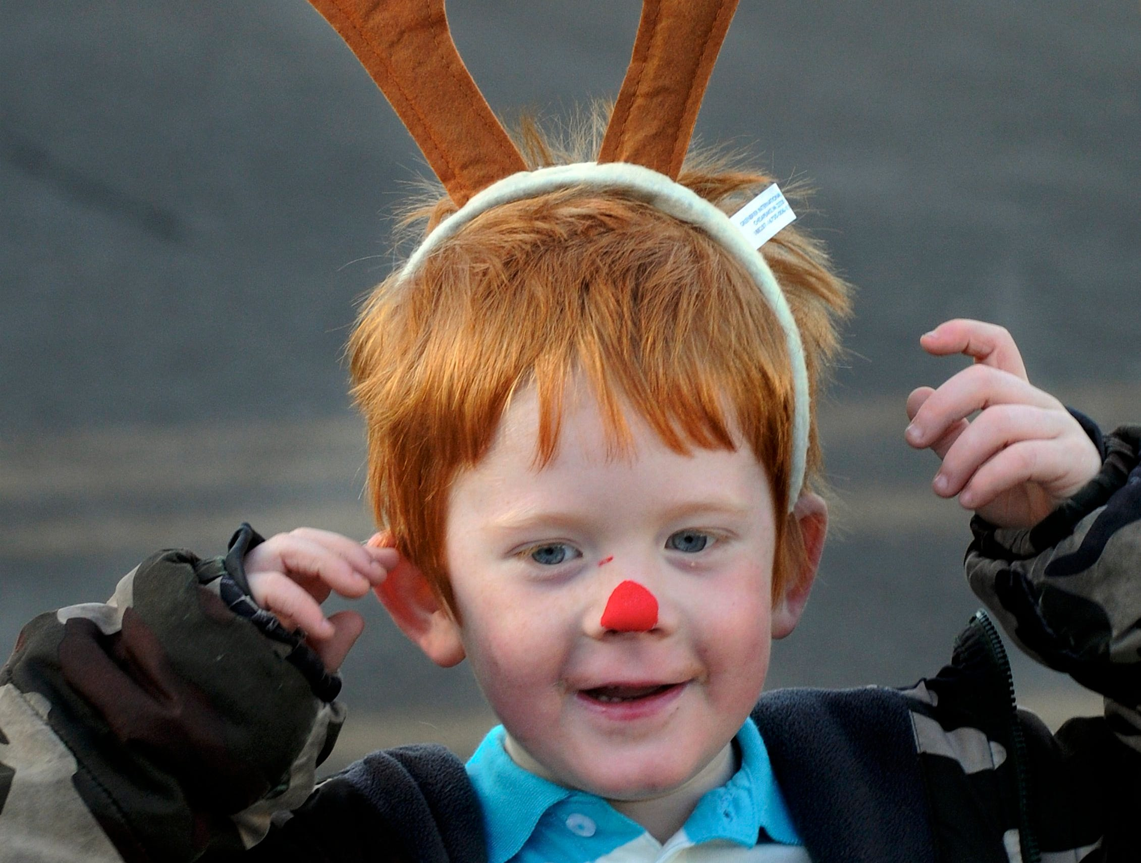 South Heights Elementary kindergarten student Ethan Mayes pauses for a antler adjustment as he takes part in the schools annual Christmas Parade Thursday morning.  12-19-2013