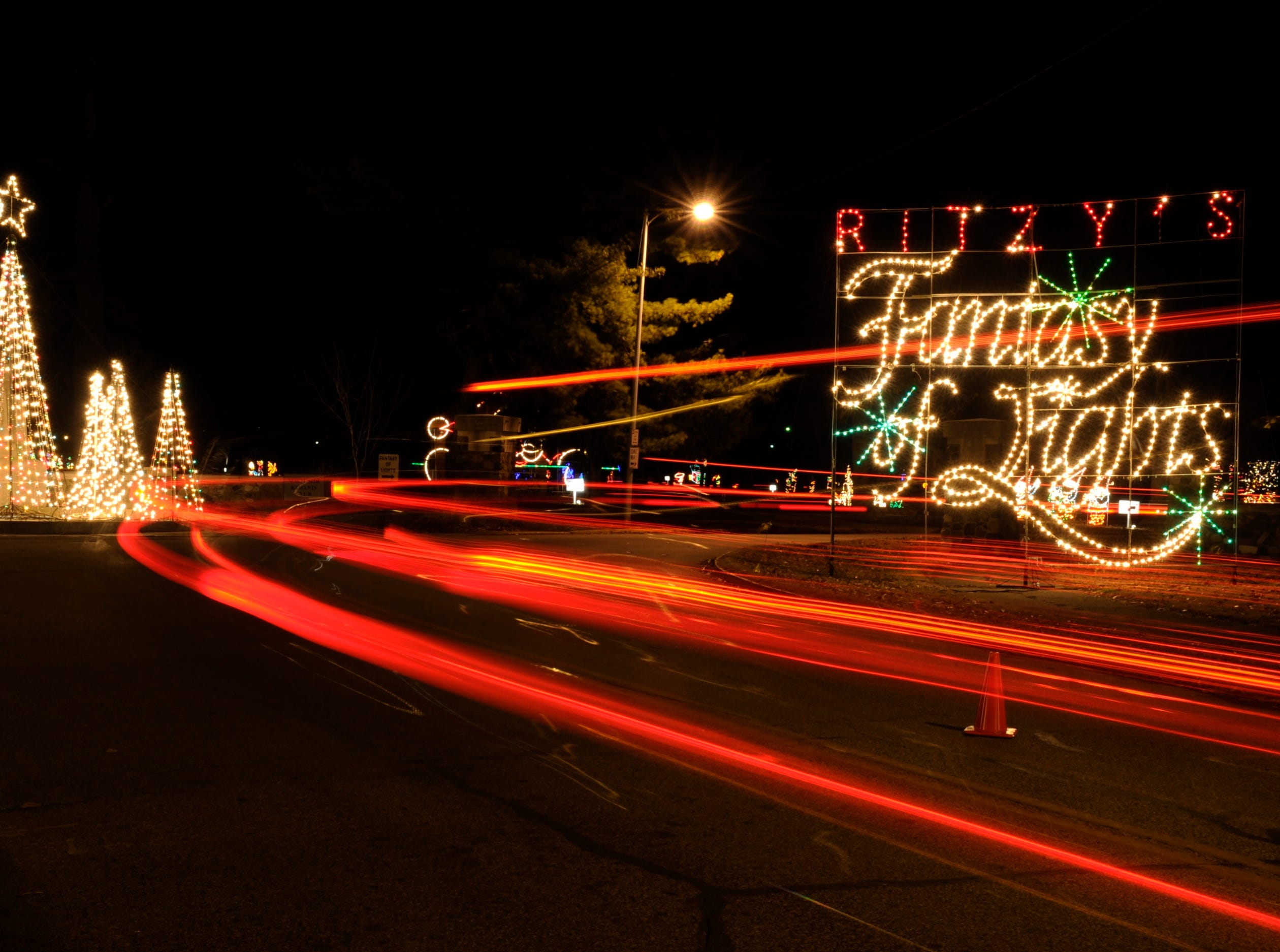 Visitors taillights become blurs of light in this time exposure of the Ritzy's Fantasy of Lights in Garvin Park. The light display, which raised more than $145,000 last year for Easter Seals, will remain up through Jan. 1, New Years night.