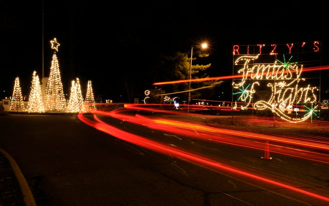 Visitors taillights become blurs of light in this time exposure of the Ritzy's Fantasy of Lights in Garvin Park.