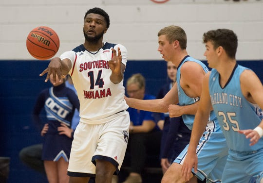 USI's Emmanuel Little (14) passes the ball during the USI vs Oakland City Men's basketball game at the PAC Tuesday, Nov. 27, 2018.