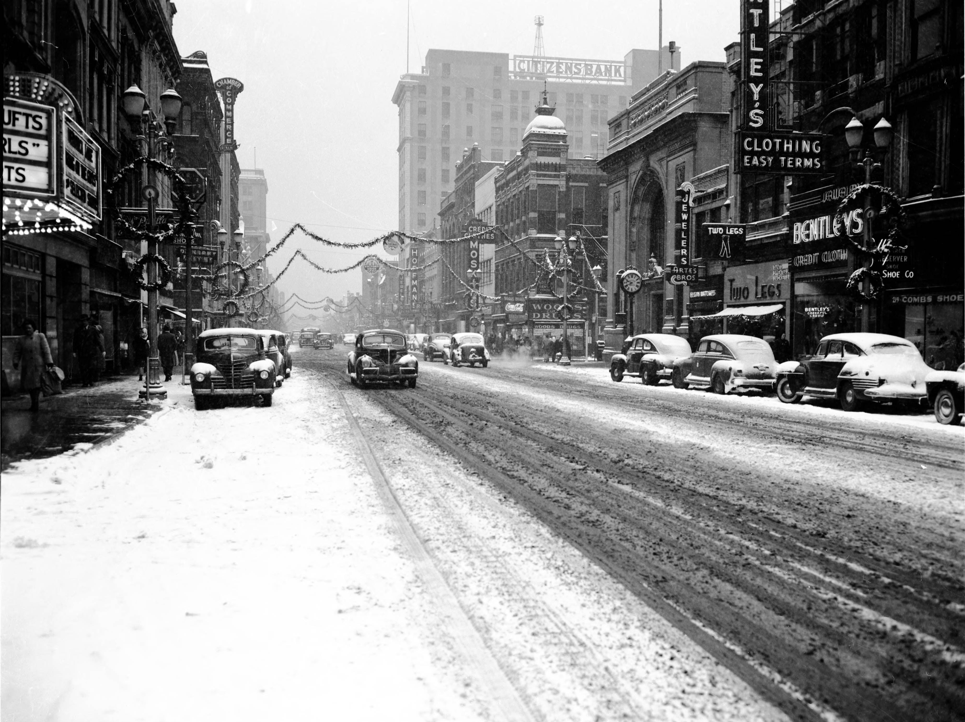 200-300 blocks of Main St., with snow on the ground, Christmas decorations, and an ad for war bonds in 1945.