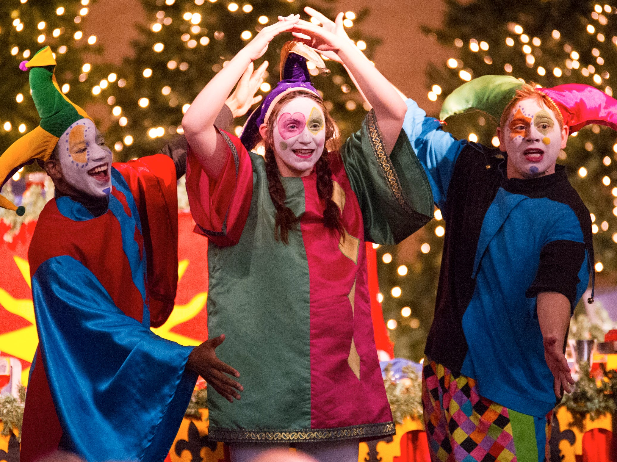From left,  Zaja Baker, Danielle Scott, Lance Grubb perform in the University of Southern Indiana's 2012 Madrigal Feaste.