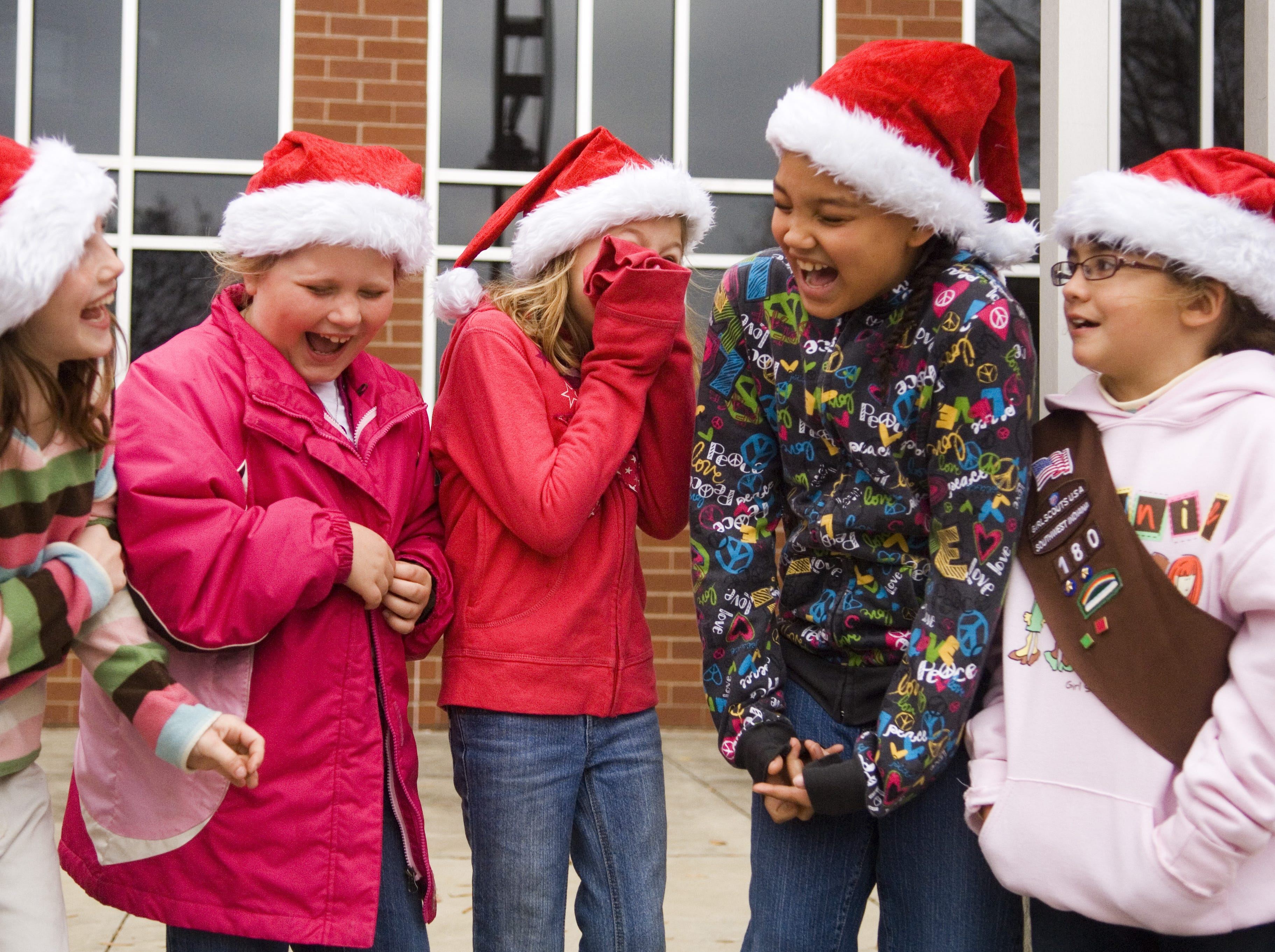 From left to right, Alexis Thompson, Morgan Leff, Claire Steinkuhl, Kaitlyn Johnson, and Lucy Belwood, allof Brownie Troop 180, laugh as they wait for one of their leaders before marching in the 2010 annual Downtown Evansville Holiday Parade on Sunday, November 21, 2010.
