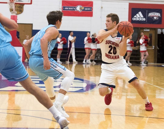 USI's Alex Stein (20) looks for an open man during the USI vs Oakland City Men's basketball game at the PAC Tuesday, Nov. 27, 2018.