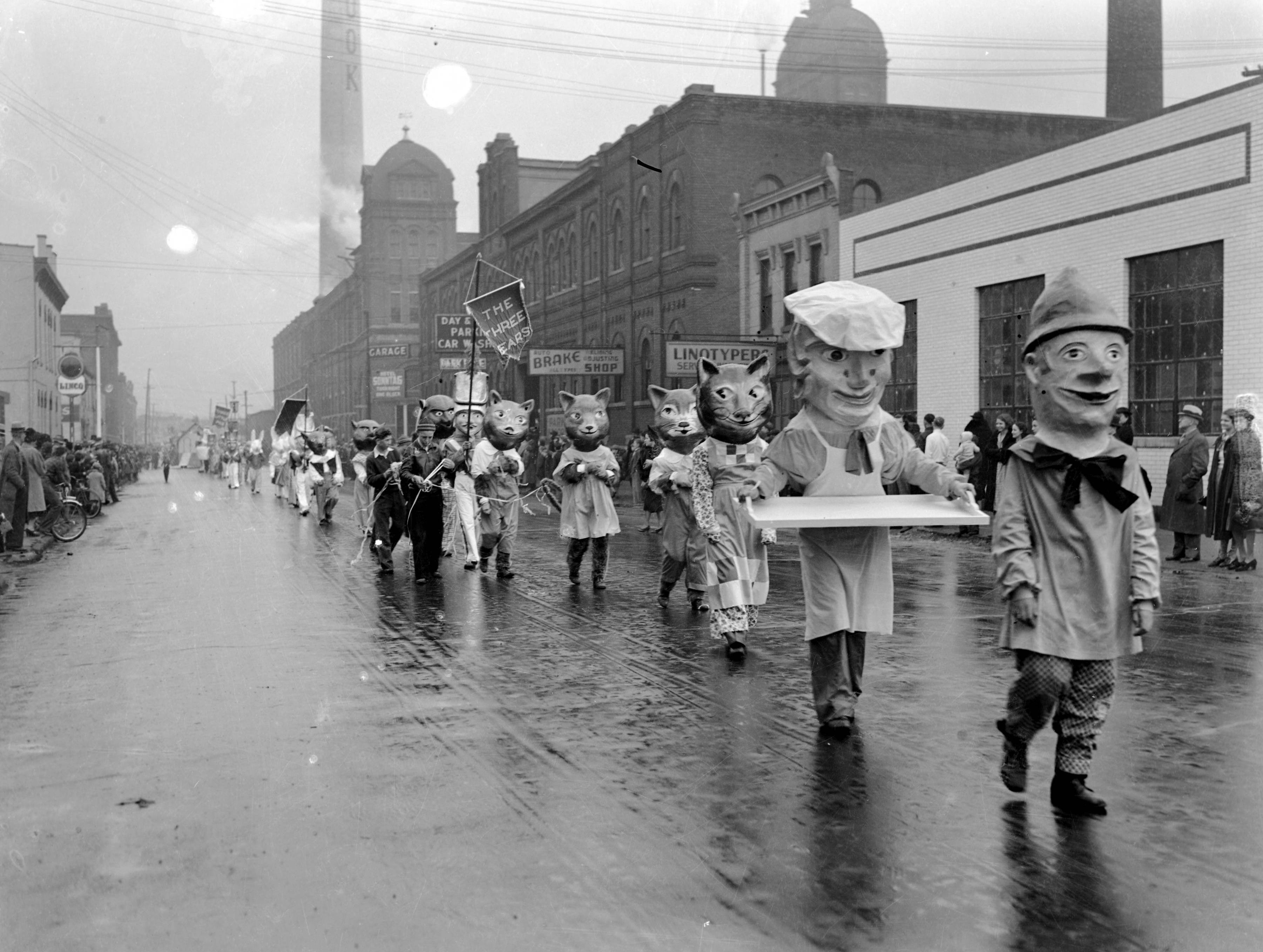 WPA Christmas Parade floats with various paper Mache head figures--a baker, cats, the 3 bears, etc in 1939.