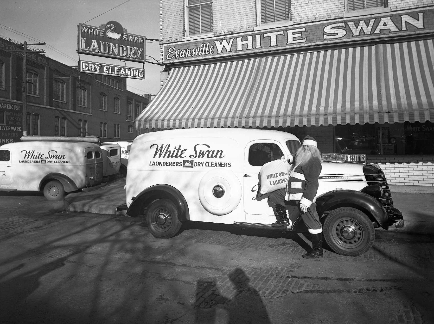 History Lesson is a pictorial history of Evansville provided by Patricia Sides, an archivist with Willard Library Santa Claus Visits White Swan Laundry This image was used in an advertisement for White Swan Laundry in December 1937, which touted its delivery service as a Christmas gift for her. Santa prepares to inaugurate the first of 52 visits the company's routemen were scheduled to make in 1938. At four cents per pound of laundry, the weekly service was a timesaving bargain for busy housewives throughout the year. The company was located at NW Second and Ingle streets for many decades after its founding in 1893, when it became one of the first professional steam laundries to open in Evansville. It soon boasted more than 100 employees and 17 motor routes, eventually expanding its services to customers in Henderson, Ky. The business was sold in 1980, and the building was razed in 1996. (Photographer: Edgar Newman)