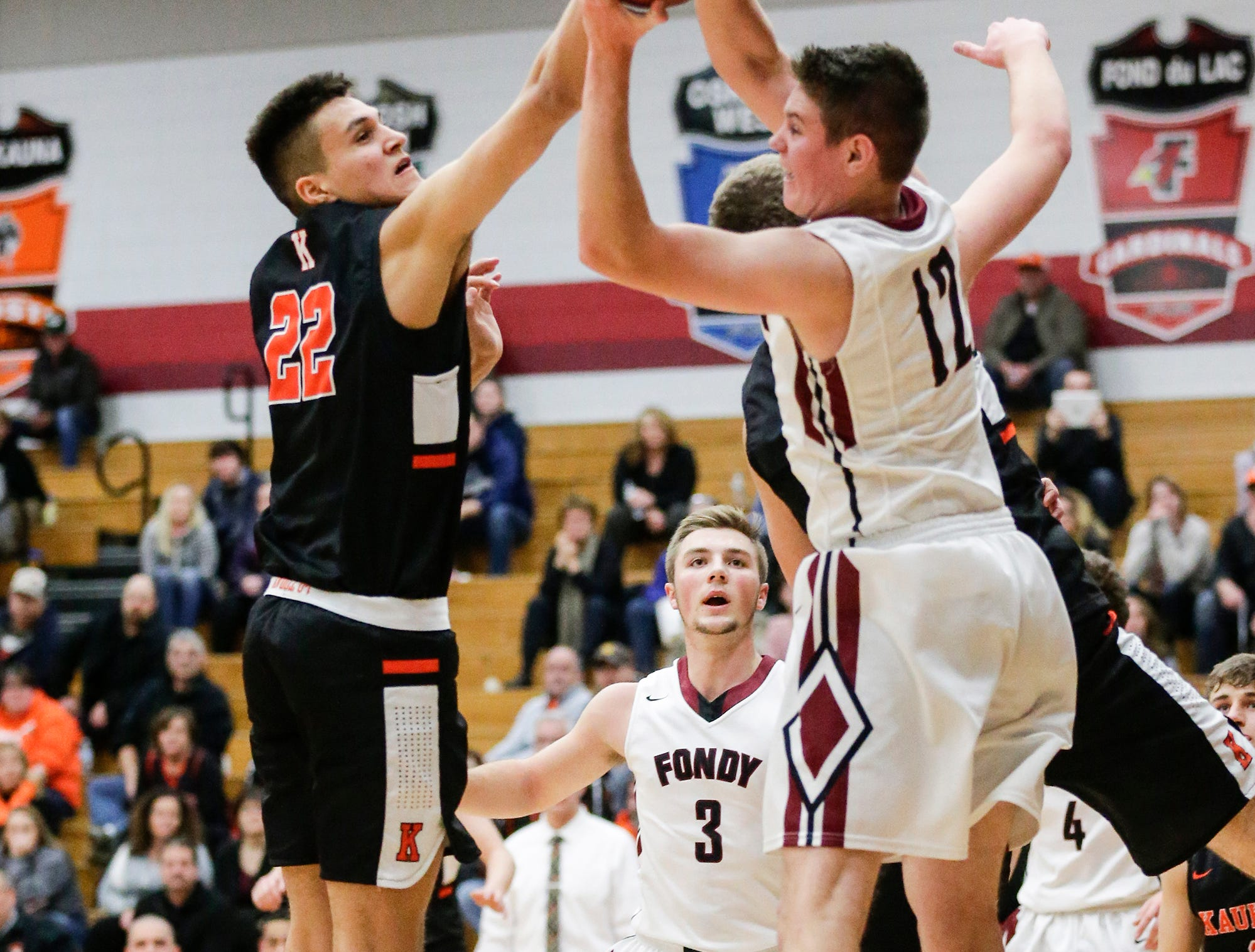 Fond du Lac High School boys basketball's Mack Sebert battles for a rebound with Kaukauna High School's Jacob Newhouse during their game Tuesday, November 27, 2018 in Fond du Lac. Doug Raflik/USA TODAY NETWORK-Wisconsin