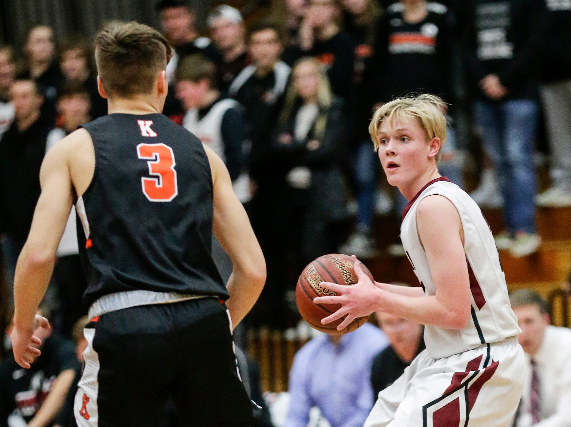 Fond du Lac High School boys basketball's Sam Nielsen looks to pass the ball against Kaukauna High School during their game Tuesday, November 27, 2018 in Fond du Lac. Doug Raflik/USA TODAY NETWORK-Wisconsin