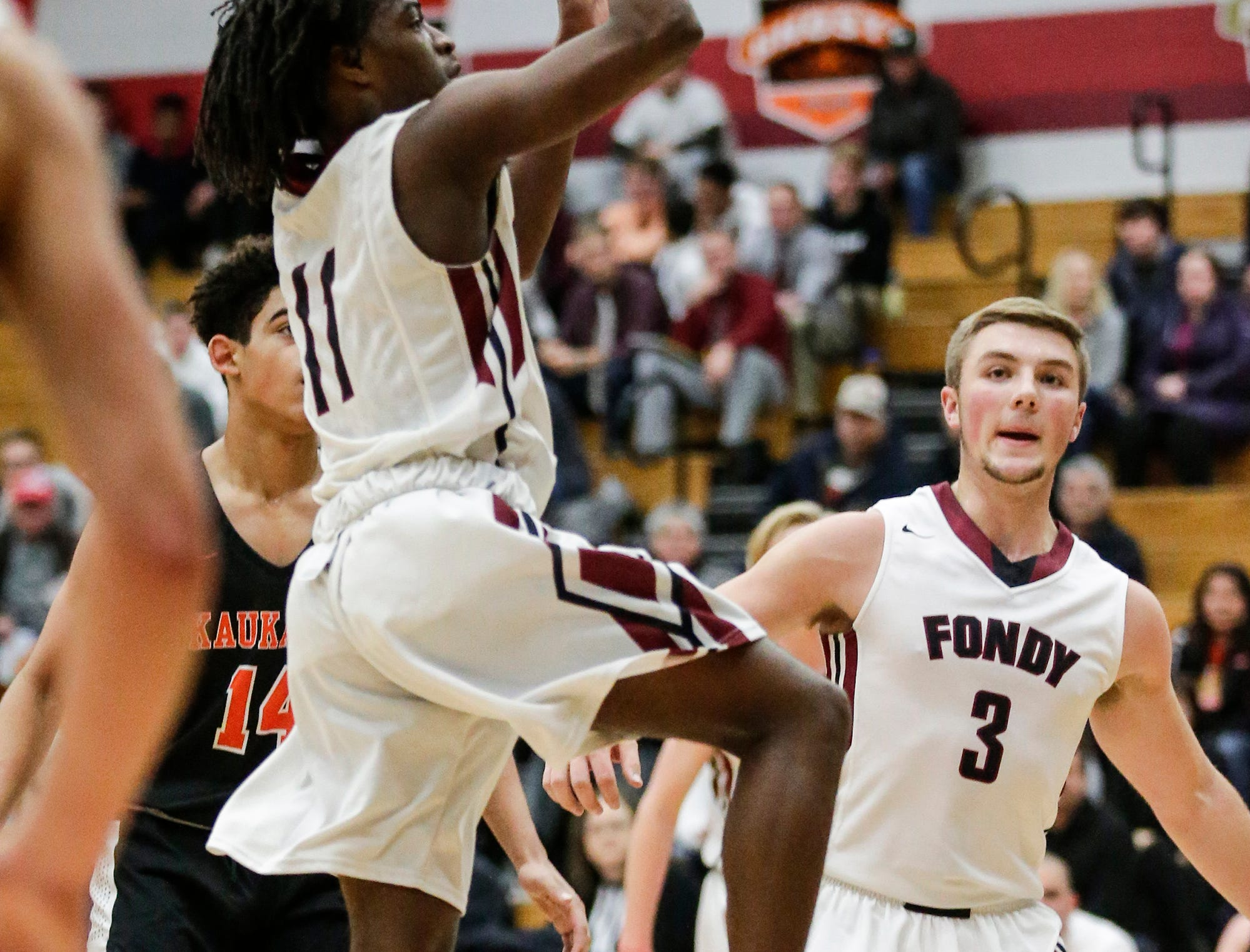 Fond du Lac High School boys basketball's London Perkins goes up for a basket against Kaukauna High School during their game Tuesday, November 27, 2018 in Fond du Lac. Doug Raflik/USA TODAY NETWORK-Wisconsin