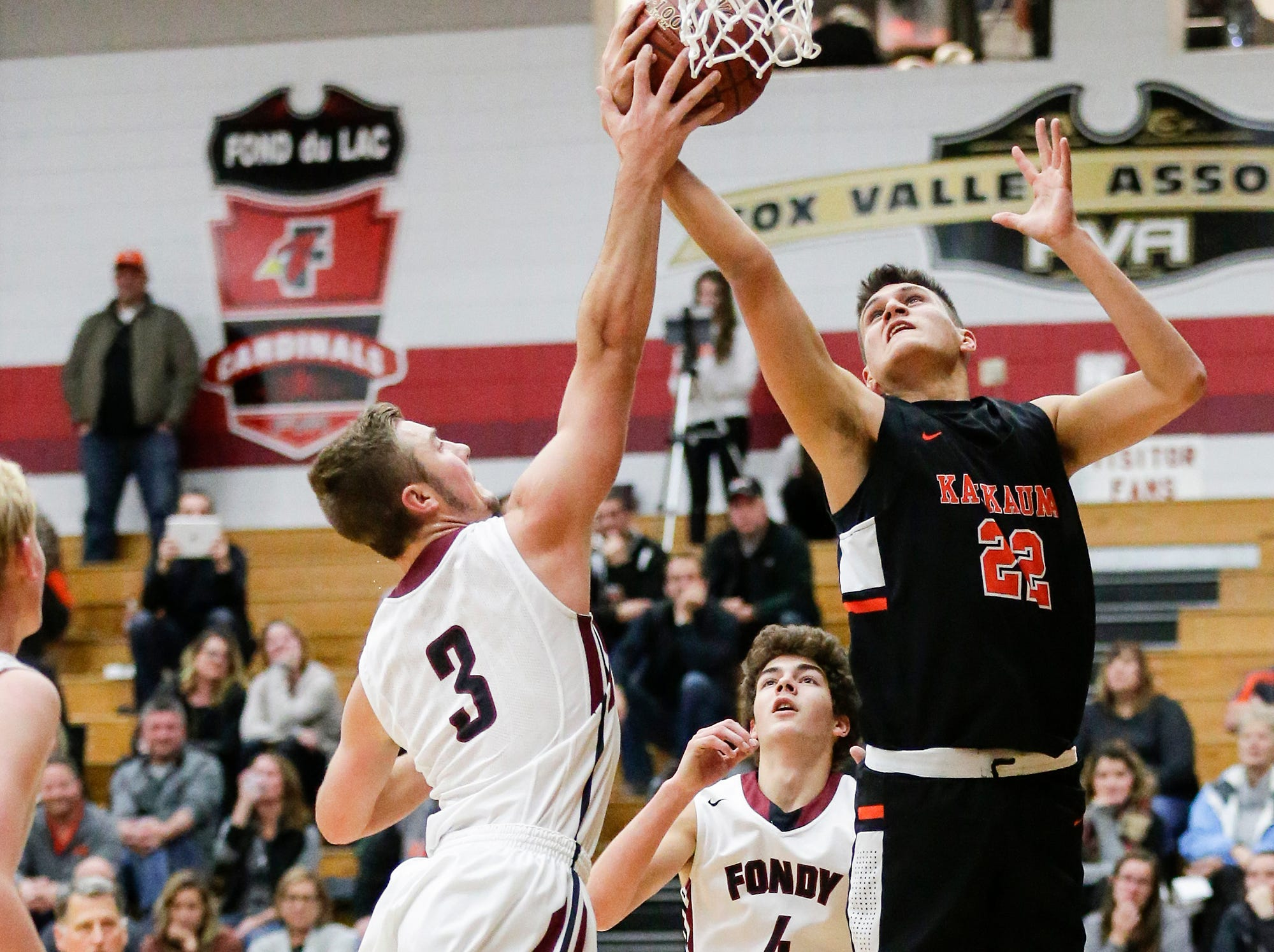 Fond du Lac High School boys basketball's Bryce Holz battles for a rebound with Kaukauna High School's Jacob Newhouse during their game Tuesday, November 27, 2018 in Fond du Lac. Doug Raflik/USA TODAY NETWORK-Wisconsin
