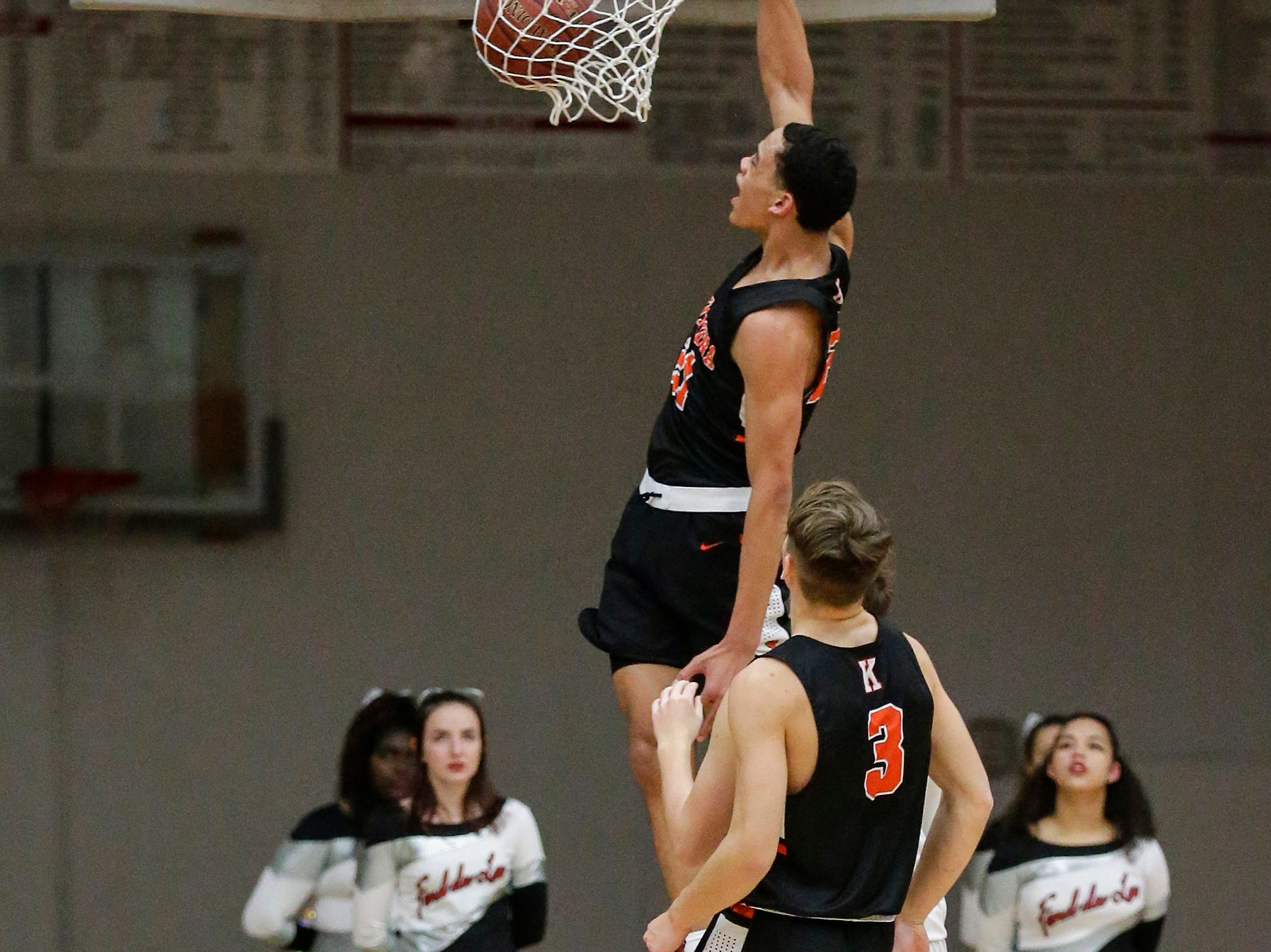 Kaukauna High School boys basketball's Donovan Ivory dunks the ball after a steal from Fond du Lac High School during their game Tuesday, November 27, 2018 in Fond du Lac. Doug Raflik/USA TODAY NETWORK-Wisconsin