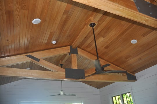 Joe Smith had to get special permission to build the roof a bit higher so he could add these vaulted wood ceilings.