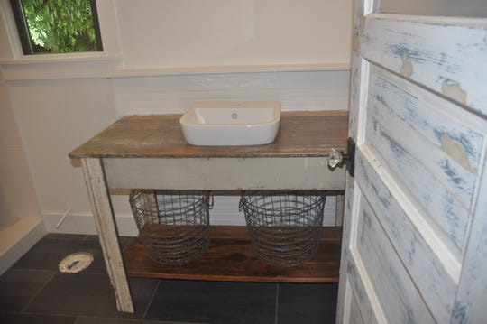 Sullivan supplemented the quaint, historic look by adding her own special touches including one of the sinks from a nearby historic cottage.
