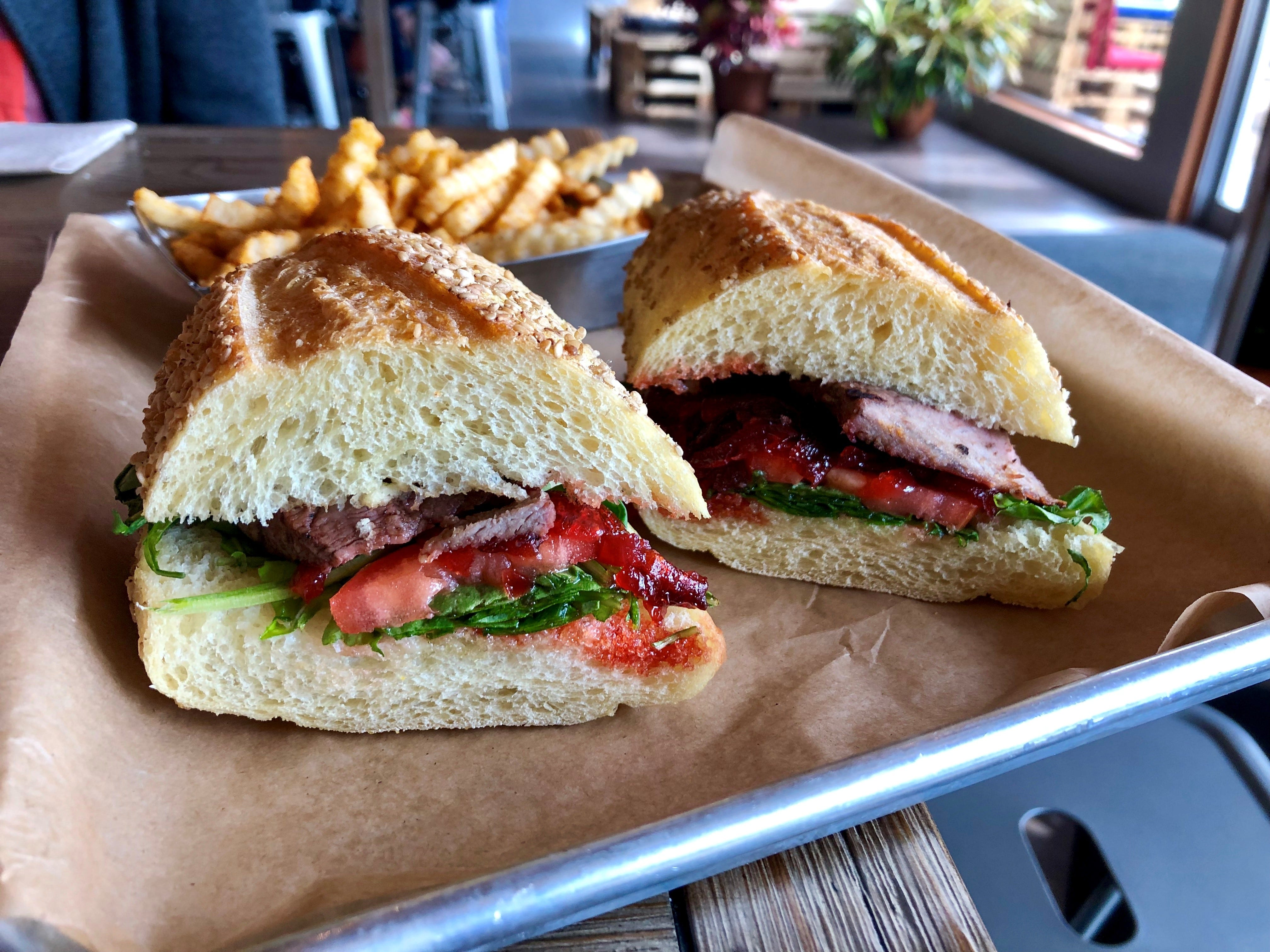 """""""The Duke"""" from the Backyard Beer Garden in Cape Coral is made with cooked-to-order steak, greens, tomato and candied onion jam."""