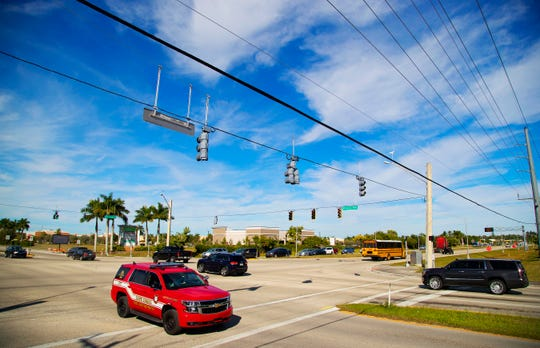 Traffic flows through the intersection of Pine Island Road and Nicholas Parkway on Wednesday in Cape Coral. The 9.4-mile stretch between U.S. 41 and Burnt Store Road has 11 stoplights and is slated to get at least two more over the next year.
