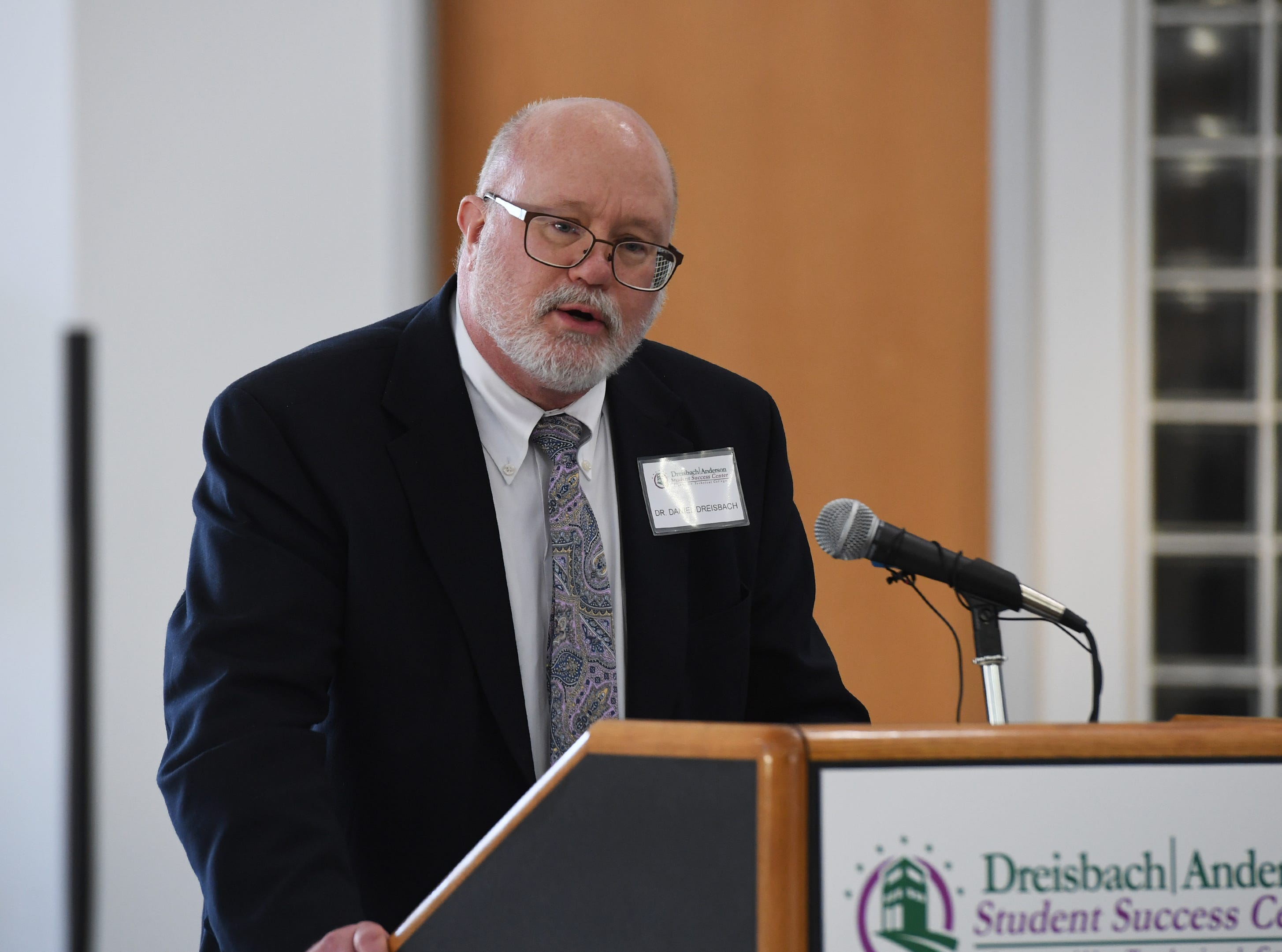 Dr. Daniel Dreisbach, a graduate of Greenville Tech., talks to the crowd at Greenville Technical College Wednesday, Nov. 28, 2018. Dodie Anderson, a former classmate of Dreisbach's, donated $2 million, which will be used for The Dreisbach/Anderson Student Success Center.