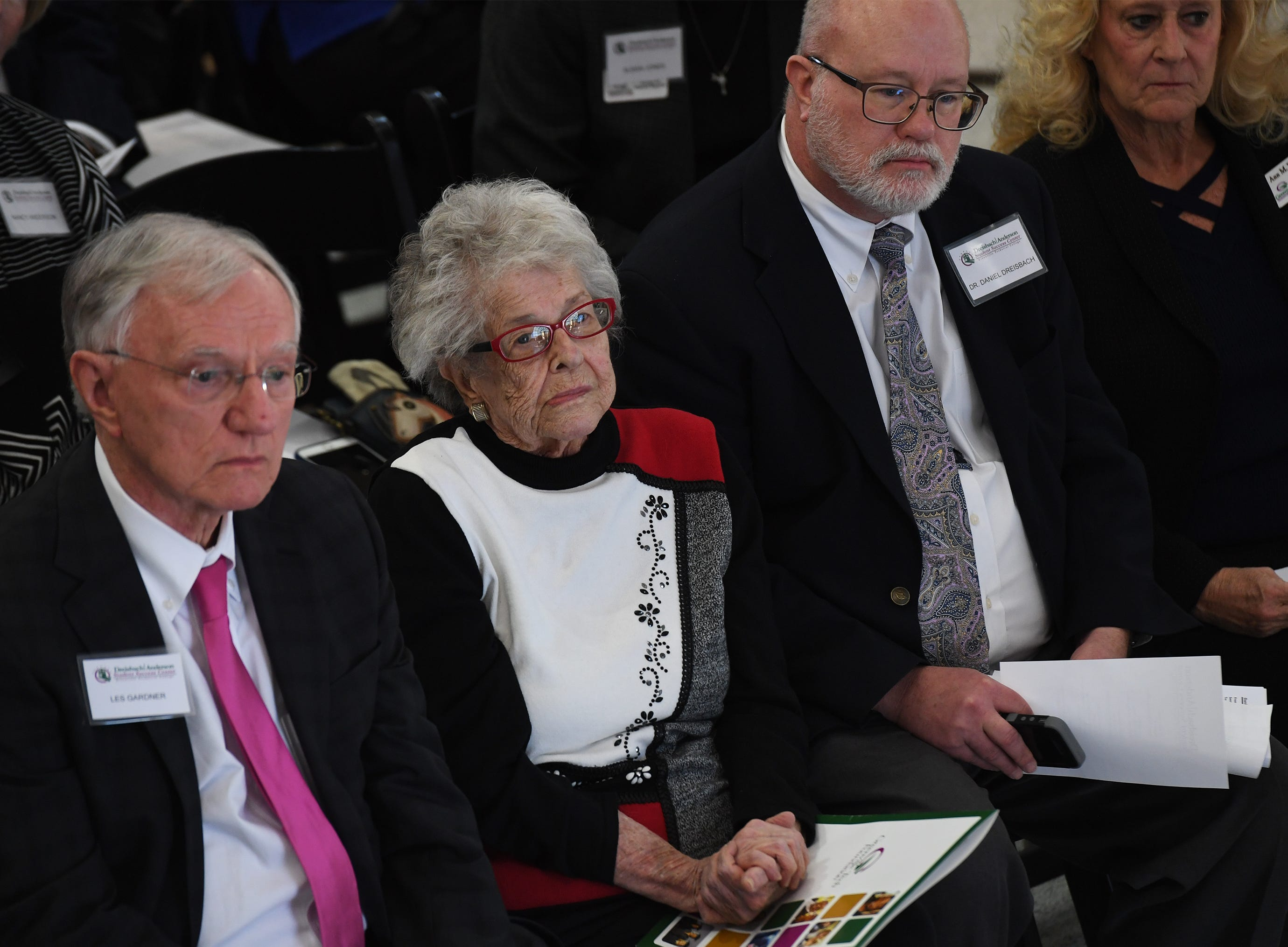 From left, Les Gardner, Dodie Anderson, Dr. Daniel Dreisback and Ann Wright listen to Dr. Keith Miller, president of Greenville Technical College, at Greenville Technical College Wednesday, Nov. 28, 2018.