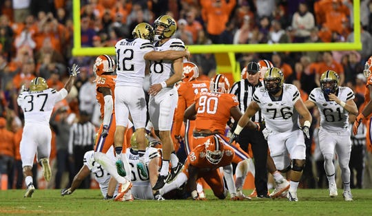 Pitt kicker Chris Blewitt (12) celebrates with Pitt holder Ryan Winslow (18) after kicking the game winning field goal against Clemson with 6 seconds left in the game on Saturday, November 12, 2016 at Clemson's Memorial Stadium.