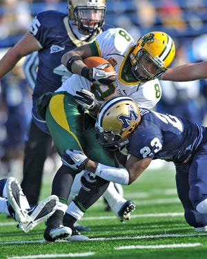 Montana State's Jody Owens tackles North Dakota State's D.J. McNorton in an FCS playoff game in Bozeman in 2010.
