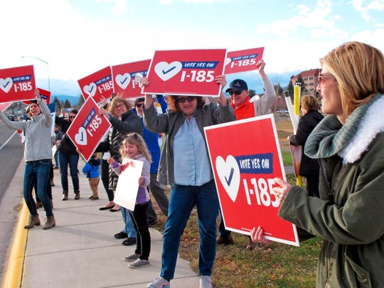 FILE - In this Friday, Nov. 5, 2018 file photo, supporters of a Montana ballot initiative to extend the state's Medicaid expansion program and raise tobacco taxes rally in Helena, Mont. The $26.1 million campaign to decide whether to raise tobacco taxes to pay for the Montana's Medicaid expansion program was the state's most expensive ballot measure in at least the last 16 years. Data from the National Institute on Money in Politics also shows the measure defeated earlier this month is also the nation's most expensive tobacco tax measure outside of California since 2002. (AP Photo/Matt Volz,File)