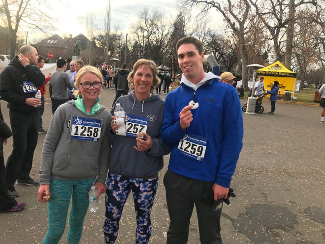 The donuts were the best part of the race. Abby Hutton, Lisa Schmidt and Will Early enjoy the true rewards of Burn the Bird.