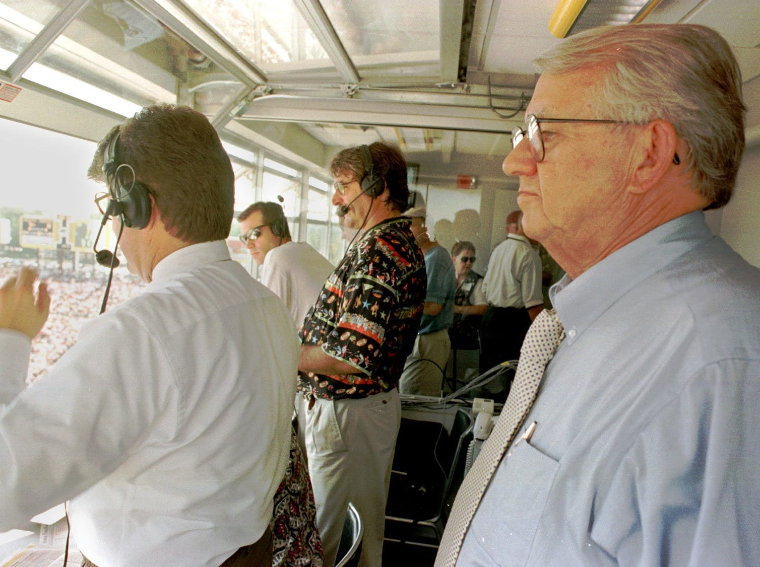 From 1997: Jim Zabel was in an unfamiliar position as an observer at Kinnick Stadium. At left is his replacement, Gary Dolphin, and analyst Ed Podolak.