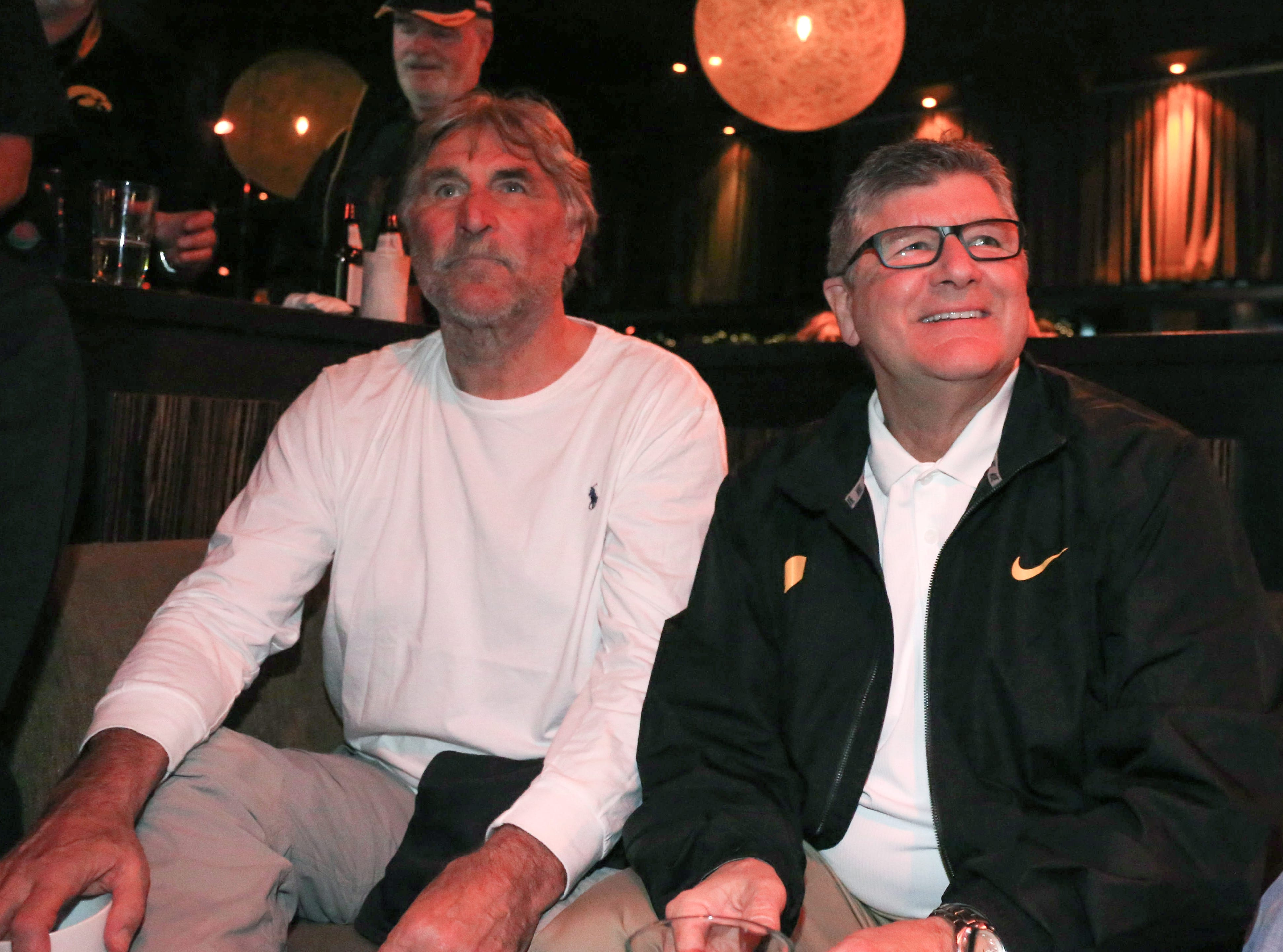 From 2015: Iowa Hawkeye broadcasters Ed Podolak, left, and Gary Dolphin watch the Iowa men's basketball team extend a lead against Michigan State from a watch party on Dec. 29, 2015, at Lucky Strike Live in Los Angeles. The Hawkeyes football team will be playing in Friday's Rose Bowl, against Stanford, in Pasadena.