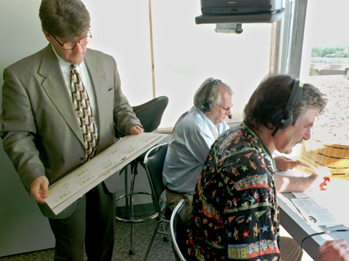 From 1997: It was Jim Zabel, background, who asked Ed Podolak, left, to become a commentator for Iowa football in 1982.