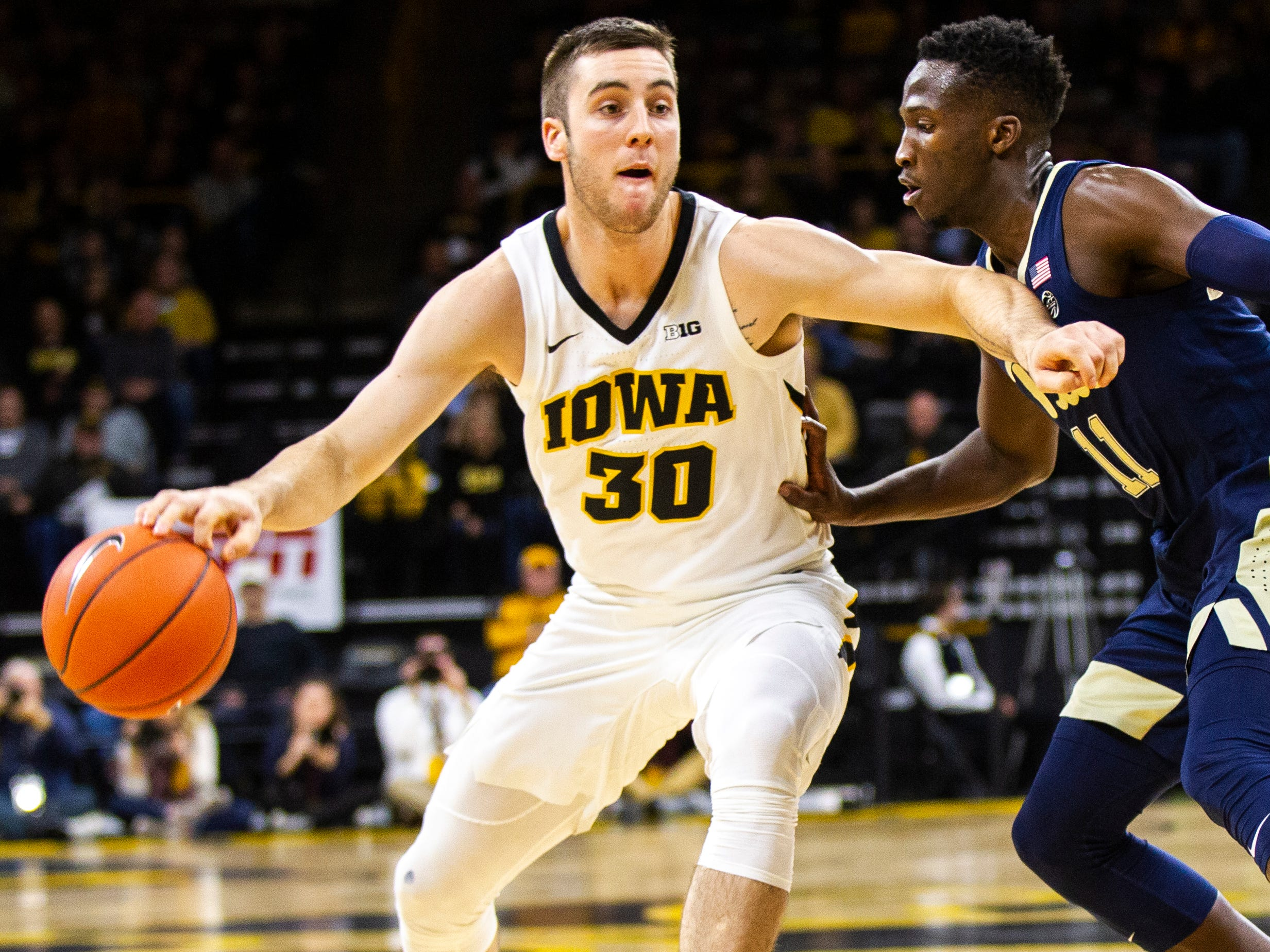 Iowa guard Connor McCaffery (30) drives to the hoop past Pittsburgh's Sidy N'Dir (11) during a NCAA men's basketball game on Tuesday, Nov. 27, 2018, at Carver-Hawkeye Arena in Iowa City.