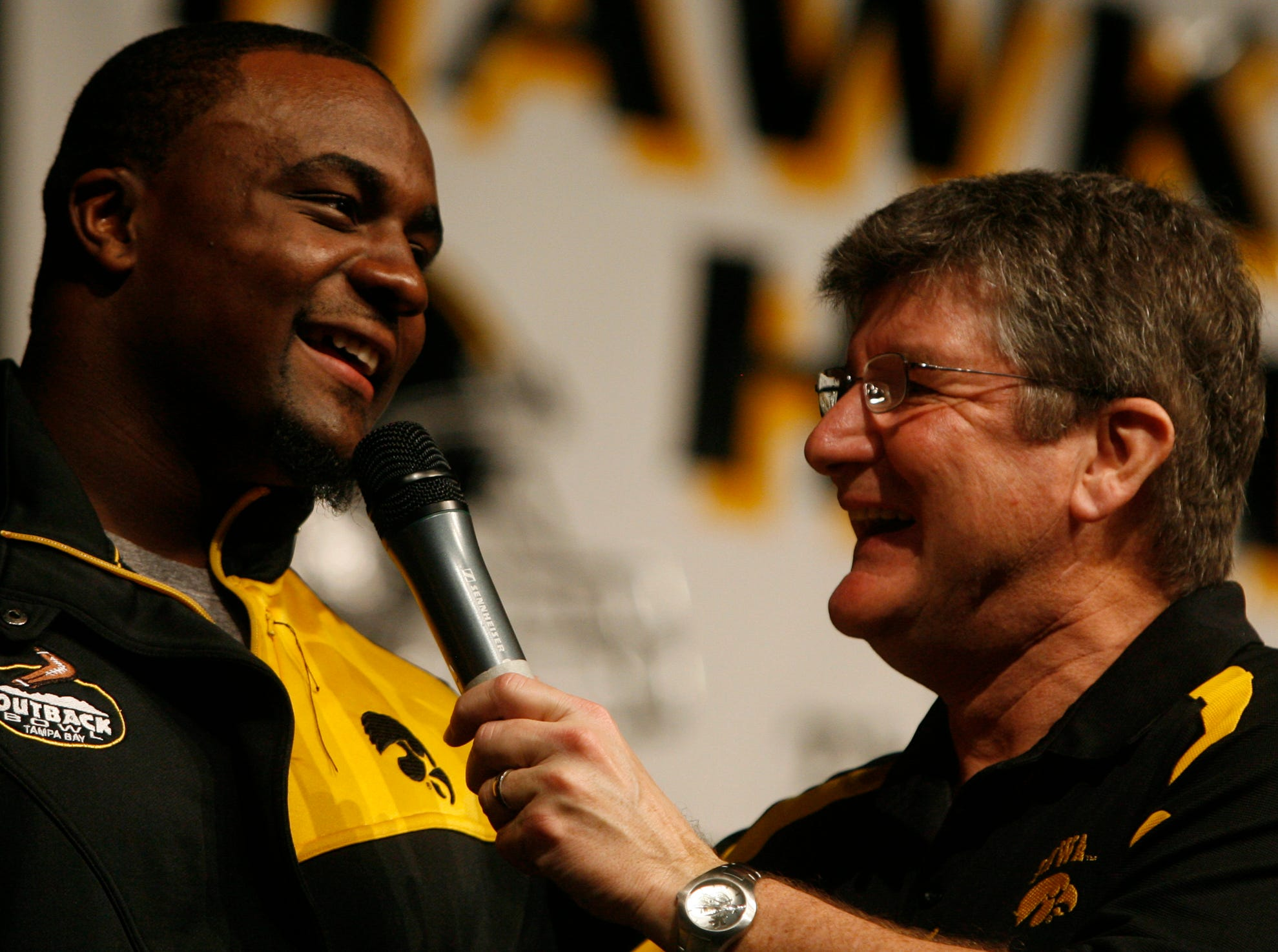 From 2008: Iowa's Shonn Greene laughs while talking with Gary Dolphin during the Hawkeye Huddle in Tampa, Florida.